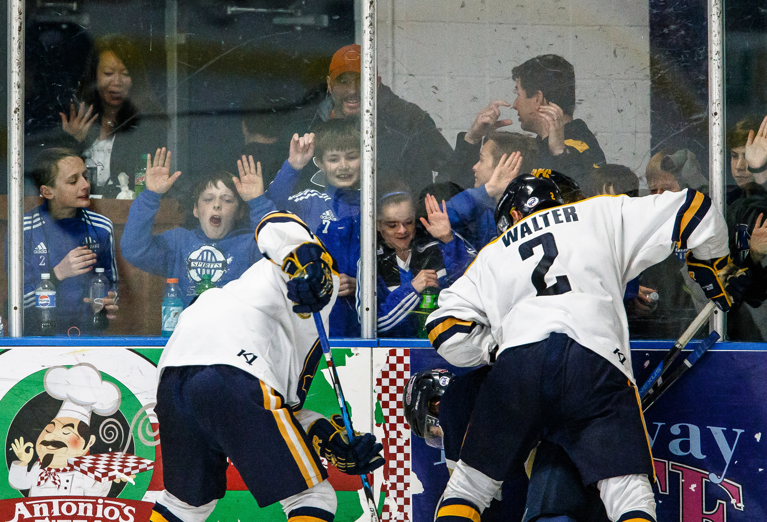 Young fans bang on the glass as the Springfield Jr. Blues take on the Janesville Jets in the second period during the first round of the first-round North American Hockey League playoff series at the Nelson Center, Friday, April 20, 2018, in Springfield, Ill. [Justin L. Fowler/The State Journal-Register]