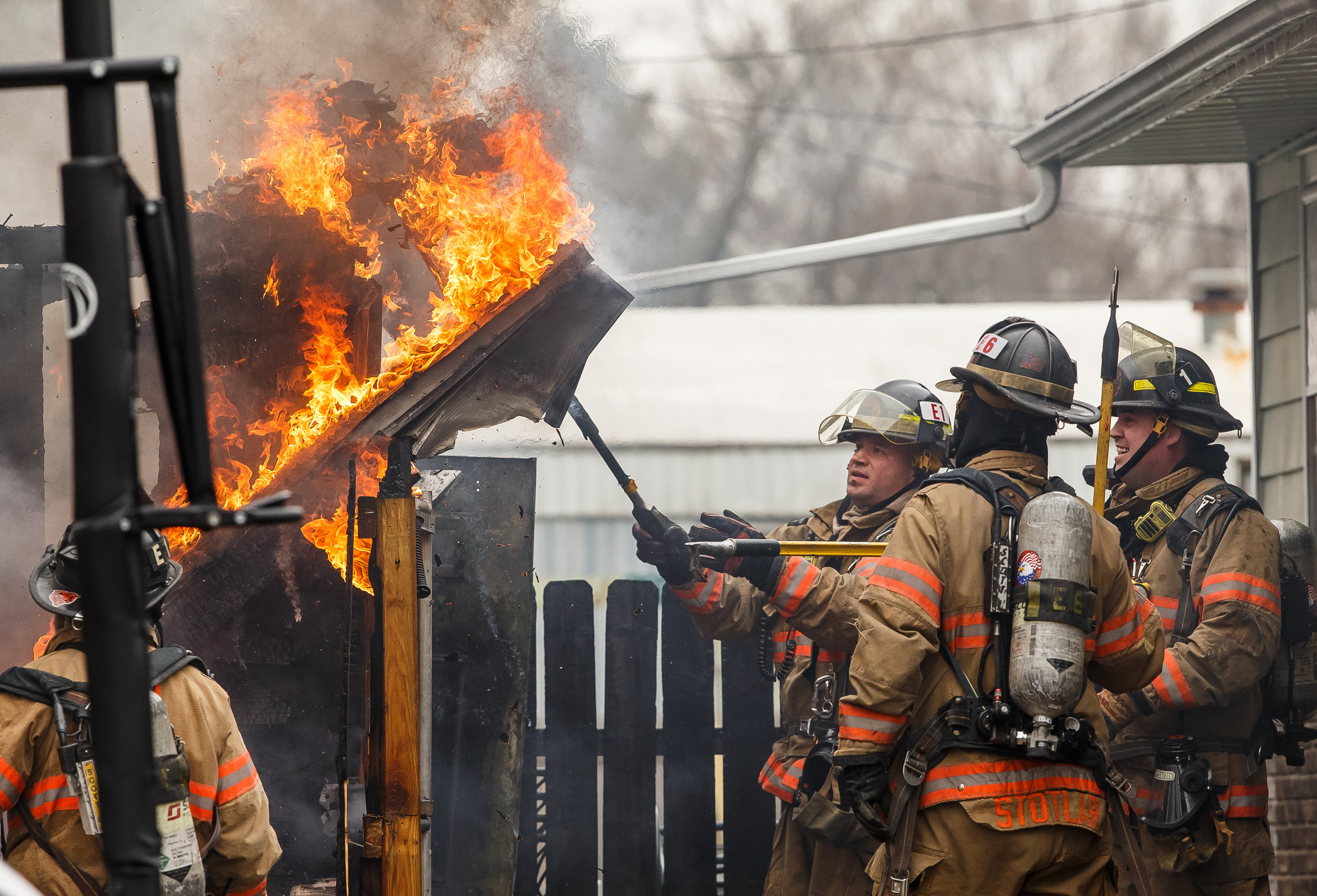 Springfield firefighters pull down the burning frame of a two car detached garage as they work to extinguish the blaze a home in the 3000 block of East Linden Avenue, Sunday, April 22, 2018, in Springfield, Ill. [Justin L. Fowler/The State Journal-Register]