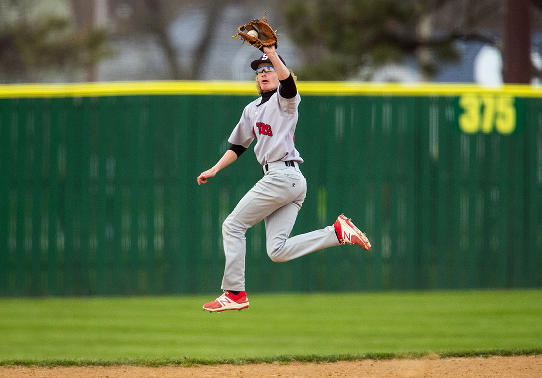 Springfield's Jackson Hyde makes a leaping catch in the infield against Sacred Heart-Griffin at Robin Roberts Stadium Wednesday, April 24, 2018. [Ted Schurter/The State Journal-Register]