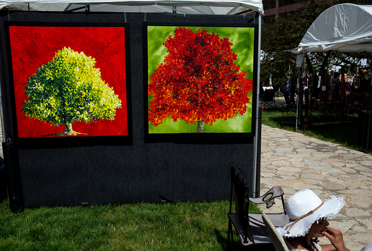 The intense colors of Lilian Delgado's florals pop out at the Old Capitol Art Festival Saturday, May 19, 2018 at the Old State Capitol in Springfield, Ill. This is the River View, Fla. artist's first year at the fair. [Rich Saal/The State Journal-Register]