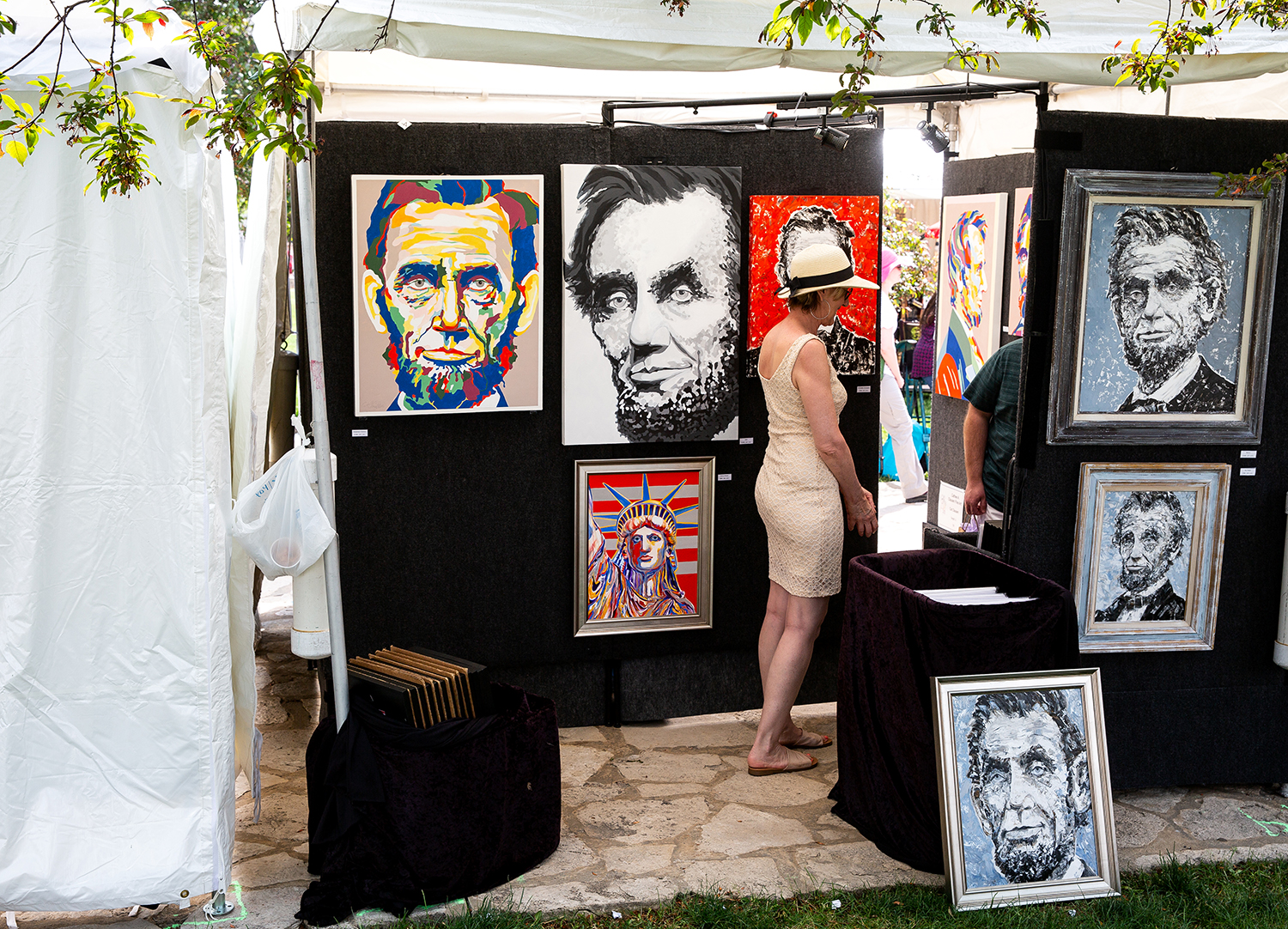 Cat Clausen brought her colorist interpretations of Abraham Lincoln and other portraits to the Old Capitol Art Festival Saturday, May 19, 2018 at the Old State Capitol in Springfield, Ill. Clausen is from Dwight.  [Rich Saal/The State Journal-Register]