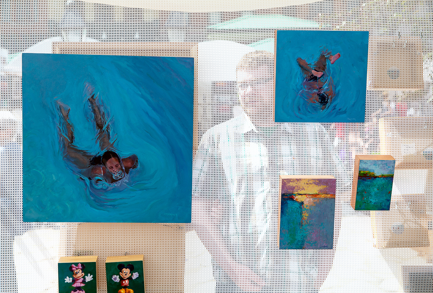 Peoria artist Cathy Engberg's oil paintings are displayed at the Old Capitol Art Festival Saturday, May 19, 2018 at the Old State Capitol in Springfield, Ill. [Rich Saal/The State Journal-Register]
