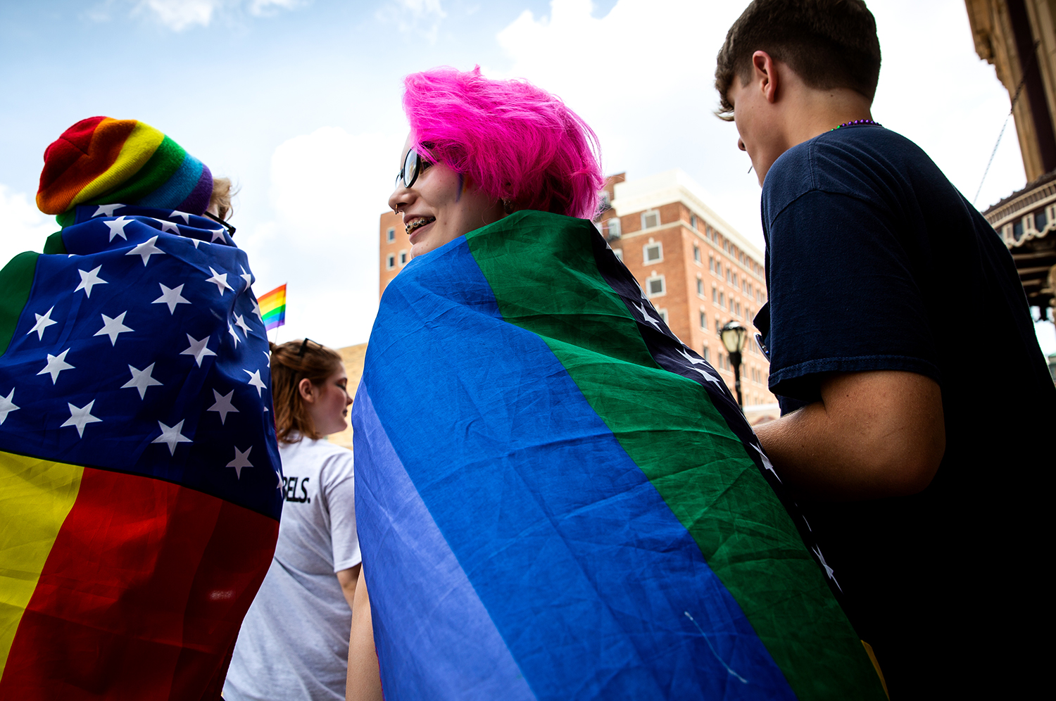 Emmorie Brown, left, Trinity Neuhaus and Joe Dipasquale hang out at Springfield's PrideFest parade and street party Saturday, May 19, 2018 at Fourth Street and Capitol Avenue in Springfield, Ill. [Rich Saal/The State Journal-Register]