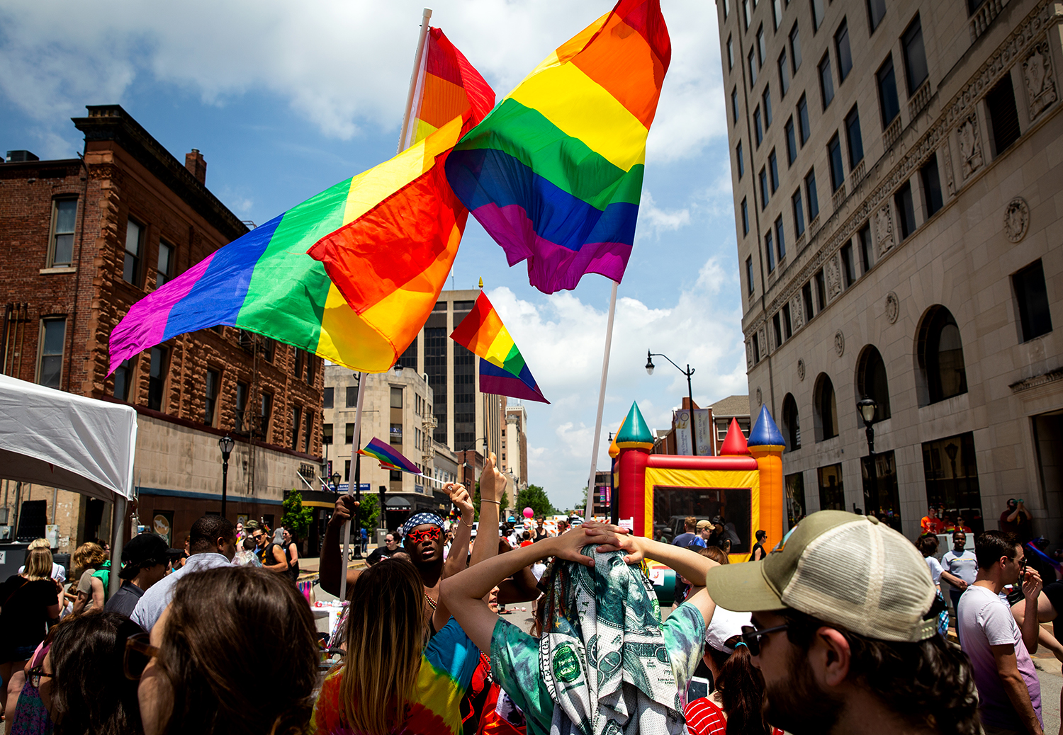 Gay pride rainbow flags fly high during Springfield's PrideFest parade and street party Saturday, May 19, 2018 in Springfield, Ill. [Rich Saal/The State Journal-Register]