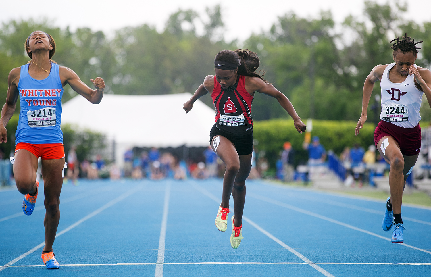 Springfield's Ozzy Erewele crosses the line .002 seconds behind Danville's Ameia Wilson to take third place in the Class 3A 100 meter dash IHSA Track and Field State Finals at O'Brien Field in Charleston, Ill., Saturday, May 19, 2018.  [Ted Schurter/The State Journal-Register]