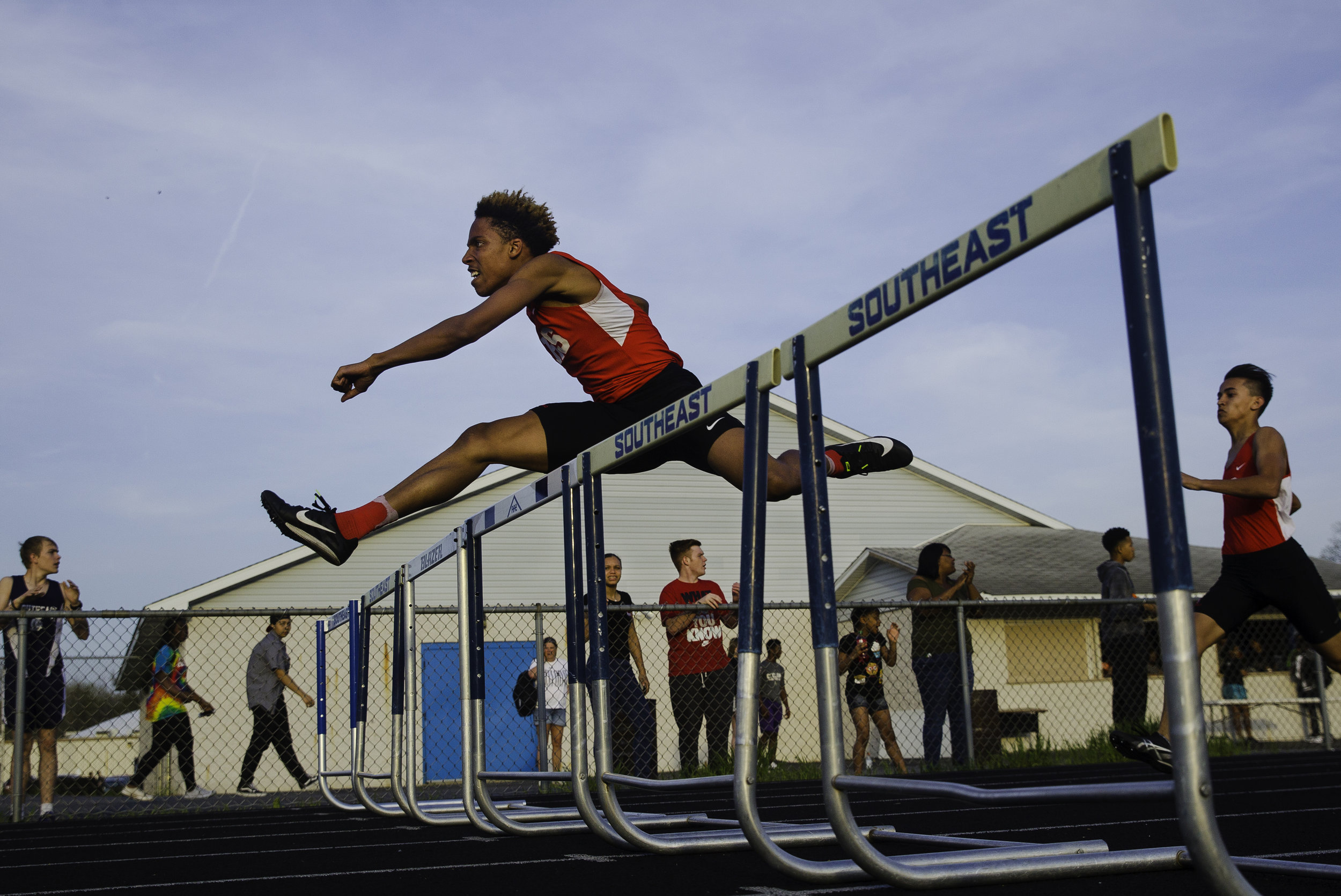 Springfield's Robert Williams clears the second to last hurdle in the 300 meter hurdles during the Boys City Track Meet at Southeast High School Tuesday, May 1, 2018. Williams won the event. [Ted Schurter/The State Journal-Register]