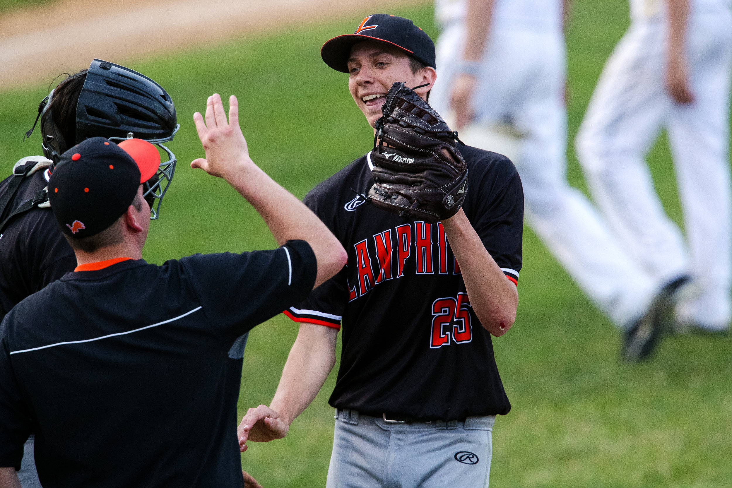 Lanphier's Austin Tomko's teammates welcome him to the dugout after his diving outfield catch against Sacred Heart-Griffin during City Series baseball at Robin Roberts Stadium Wednesday, May 2, 2018. [Ted Schurter/The State Journal-Register]