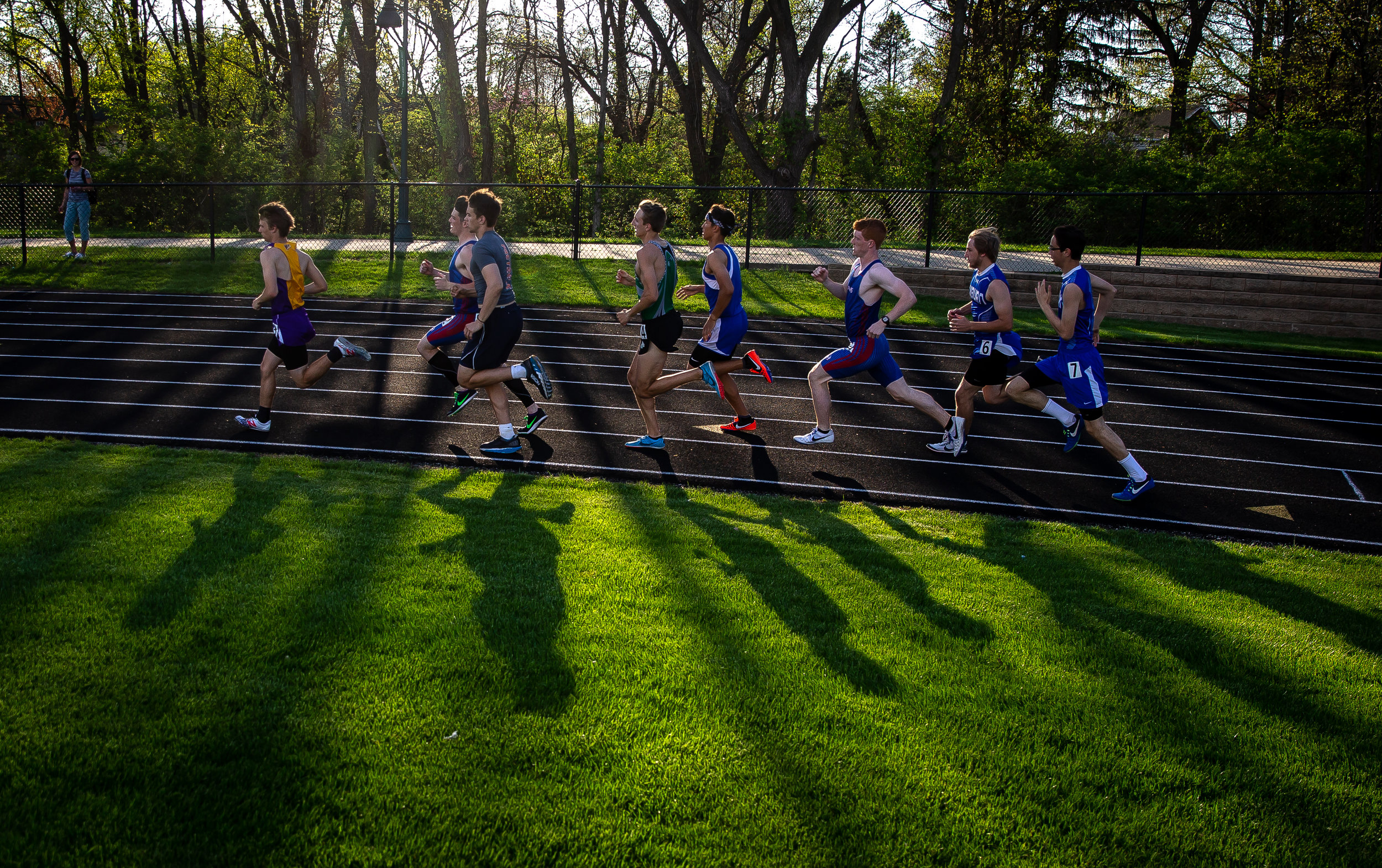 Runners round the turn on the start of the Boys 800m Run during the Sangamon County Track & Field Meet at Athens High School, Friday, May 4, 2018, in Athens, Ill. [Justin L. Fowler/The State Journal-Register]