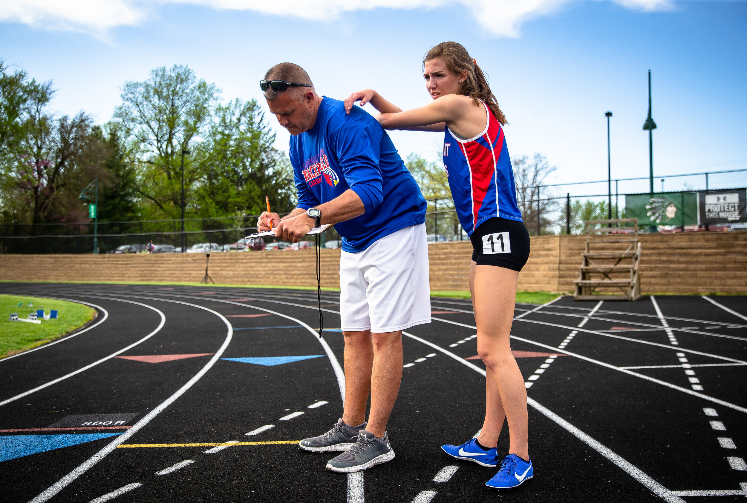 Pleasant Plains' Caroline Jachino gets a little help in recovering from Pleasant Plains girls track and field coach Rob Havens after winning the Girls 3200m Run with a time of 11:29.88 during the Sangamon County Track & Field Meet at Athens High School, Friday, May 4, 2018, in Athens, Ill. [Justin L. Fowler/The State Journal-Register]