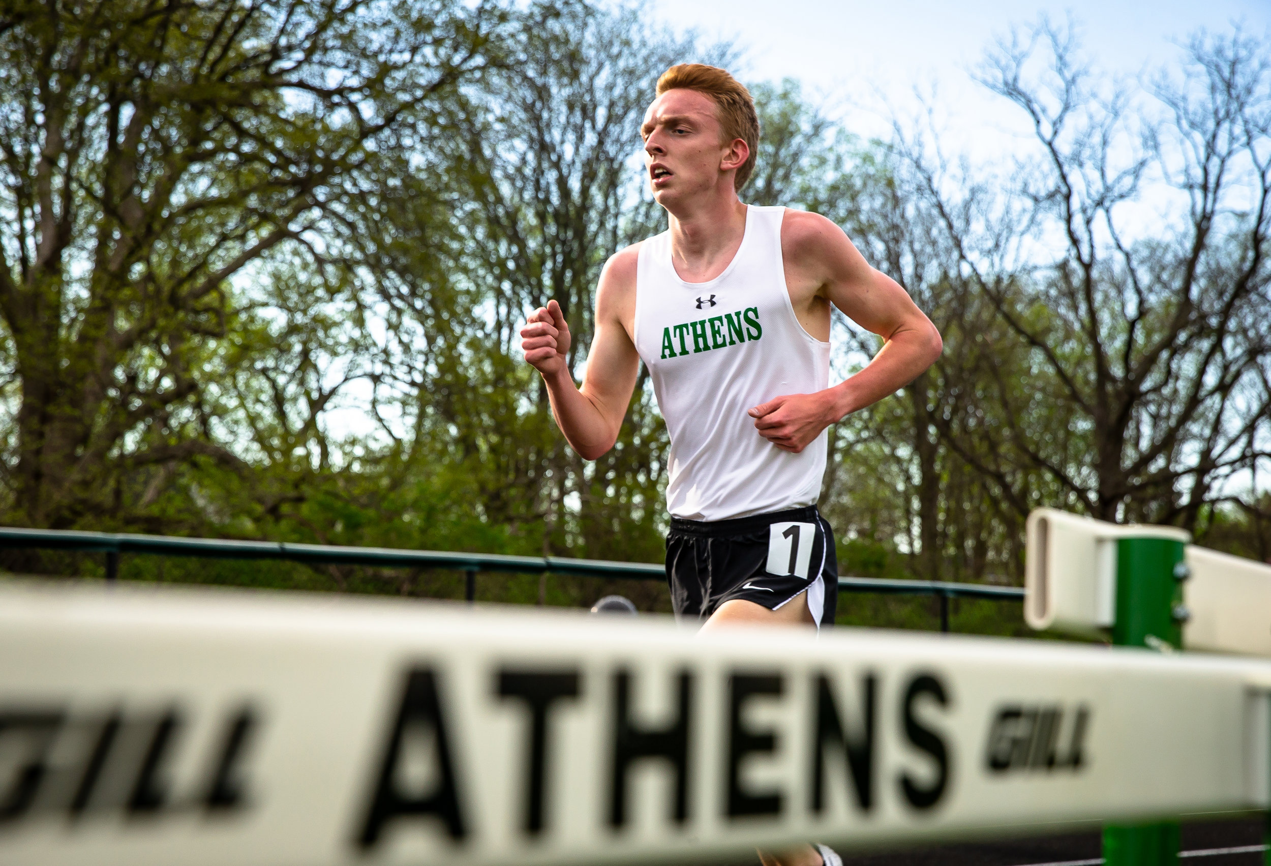 Athens' Wyatt McIntyre wins the Boys 3200m Run with a time of 9:25.19 during the Sangamon County Track & Field Meet at Athens High School, Friday, May 4, 2018, in Athens, Ill. [Justin L. Fowler/The State Journal-Register]