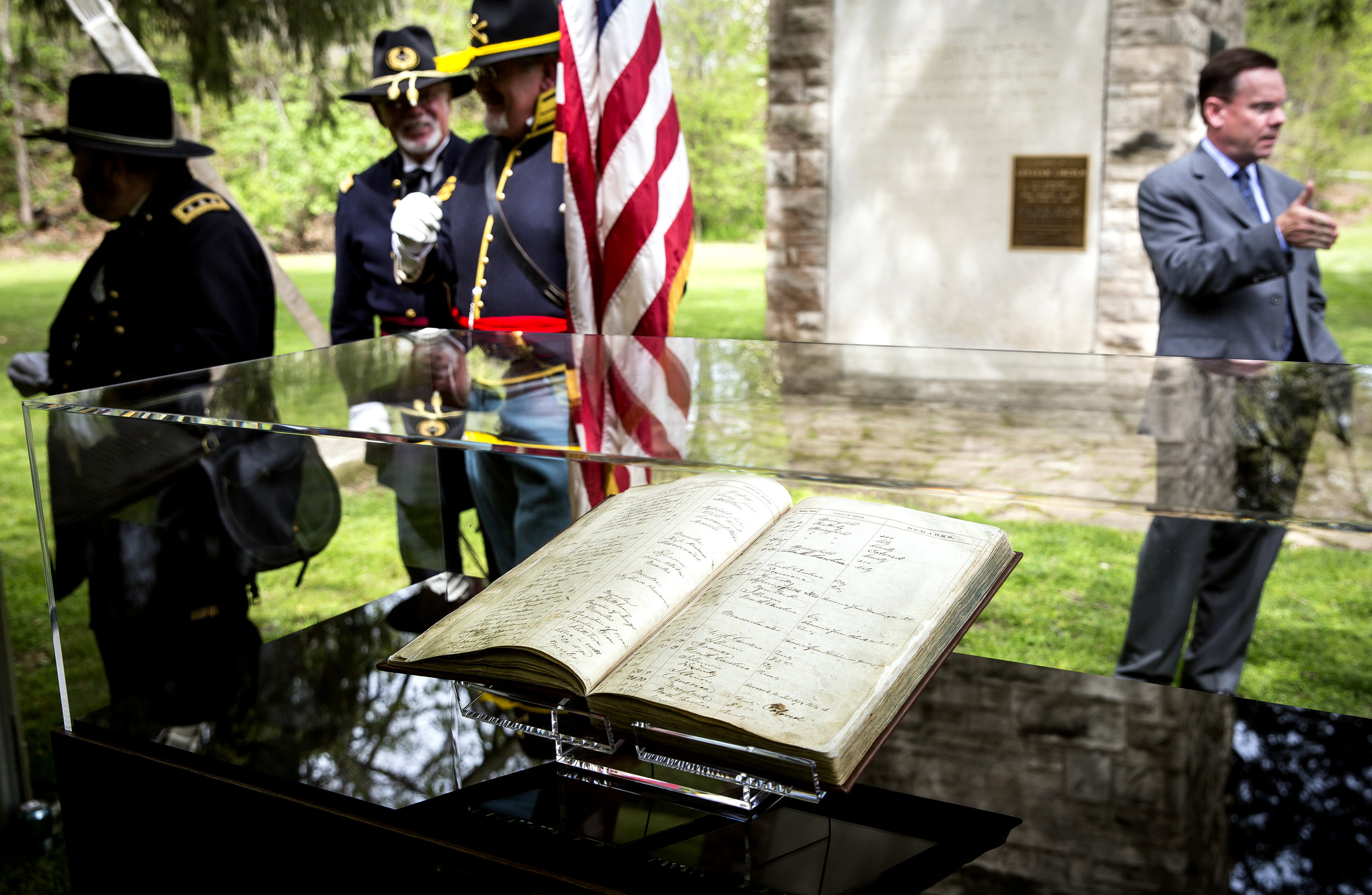 The first book kept by Oak Ridge Cemetery that recorded burials, including Abraham Lincoln and his son, Willie, has been restored and was unveiled during a ceremony Friday, May 4, 2018 near the bell tower in Oak Ridge Cemetery in Springfield, Ill. The book will eventually be stored at the Abraham Lincoln Presidential Library and Museum. [Rich Saal/The State Journal-Register]