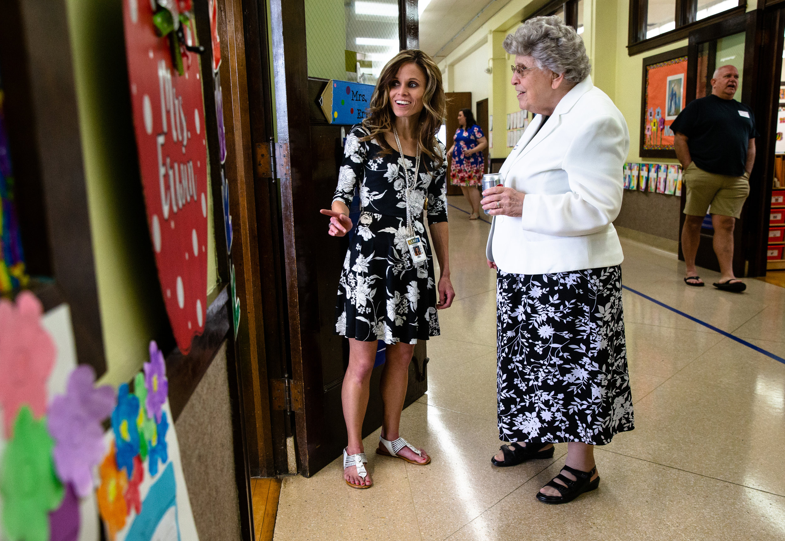Sister Mary Linda Tonellato, right, a 1951 graduate of Cathedral School, talks with kindergarten teacher Beth Erwin, center, as she tours the school's classrooms during a farewell reception, Sunday, May 6, 2018, in Springfield, Ill. The Diocese of Springfield announced earlier this year that they would close the school after the end of the the school year citing declines in enrollment and the funds to operate the school. [Justin L. Fowler/The State Journal-Register]