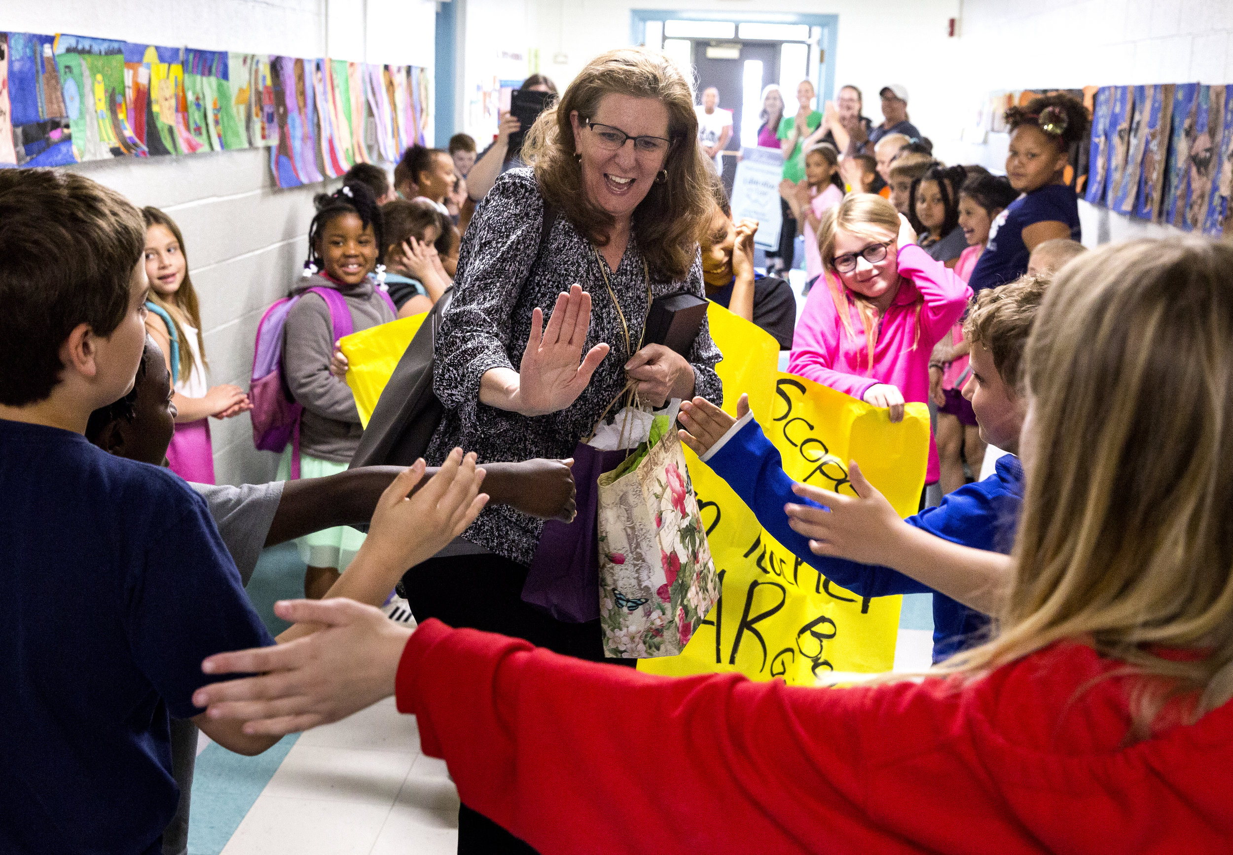 Fairview Elementary School literacy coach Lori Moore is greeted by students and staff when she returned to the school after being named the Horace Mann Educator of the Year Wednesday, May 9, 2018 at Fairview Elementary in Springfield, Ill. [Rich Saal/The State Journal-Register]