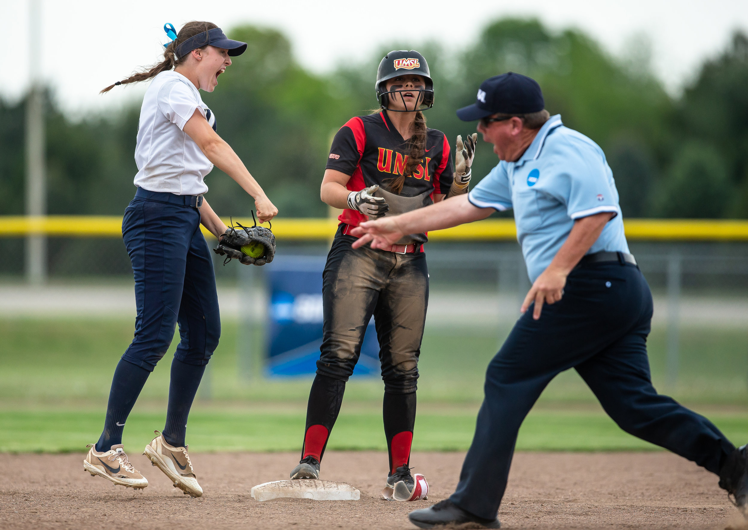 University of Illinois Springfield's Bree Derhake (6) reacts after tagging out University of Missouri-St. Louis' Reagan Osborn (18) at second base as she lifts her foot from the bag in the 9th inning in the second round of the NCAA Division II Midwest 2 Region Softball Tournament at the Land of Lincoln Junior Olympic Softball Complex, Friday, May 11, 2018, in Springfield, Ill. [Justin L. Fowler/The State Journal-Register]