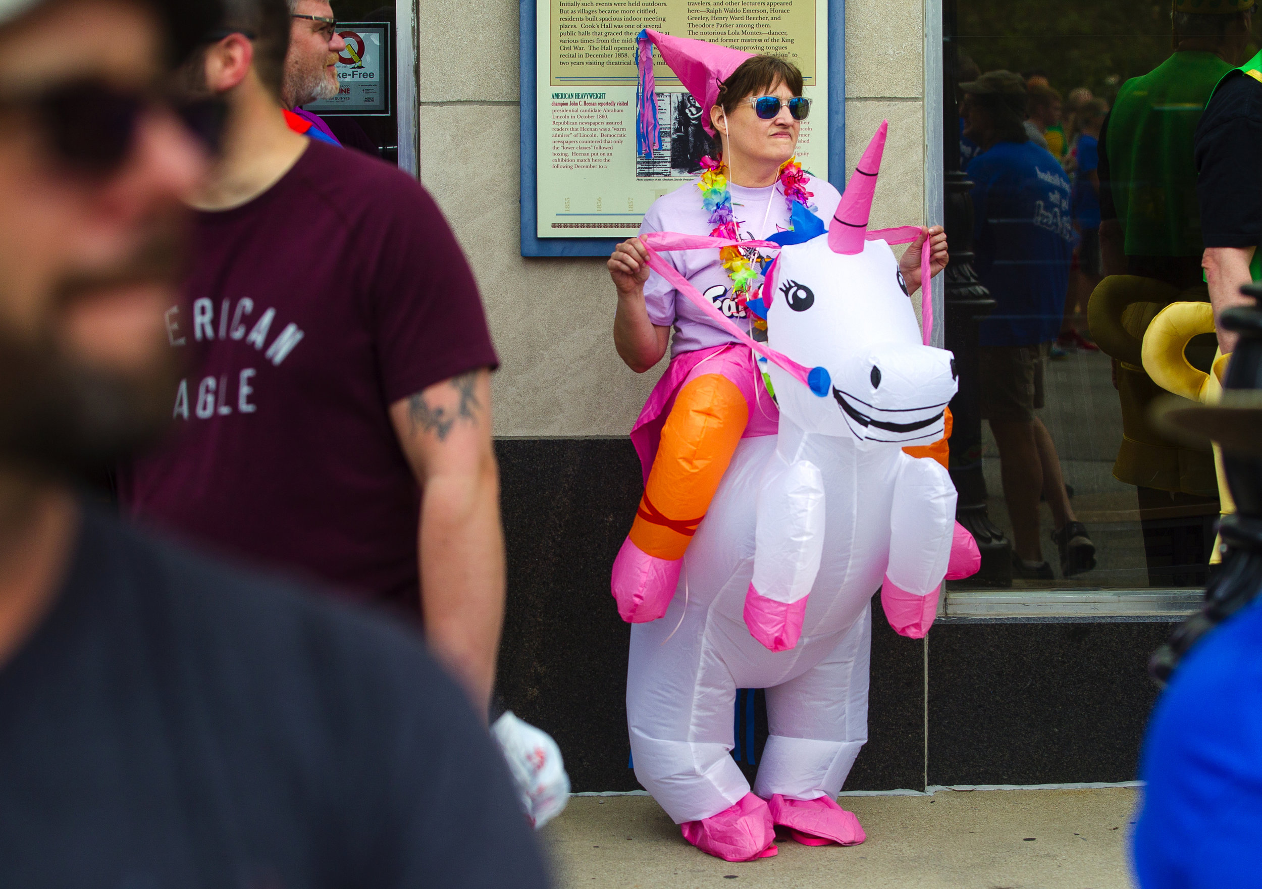 Misty Shaw waits in her unicorn costume for the begining of the Fat Ass 5K & Street Party for Charity in downtown Springfield Saturday, May 12, 2018. [Ted Schurter/The State Journal-Register]