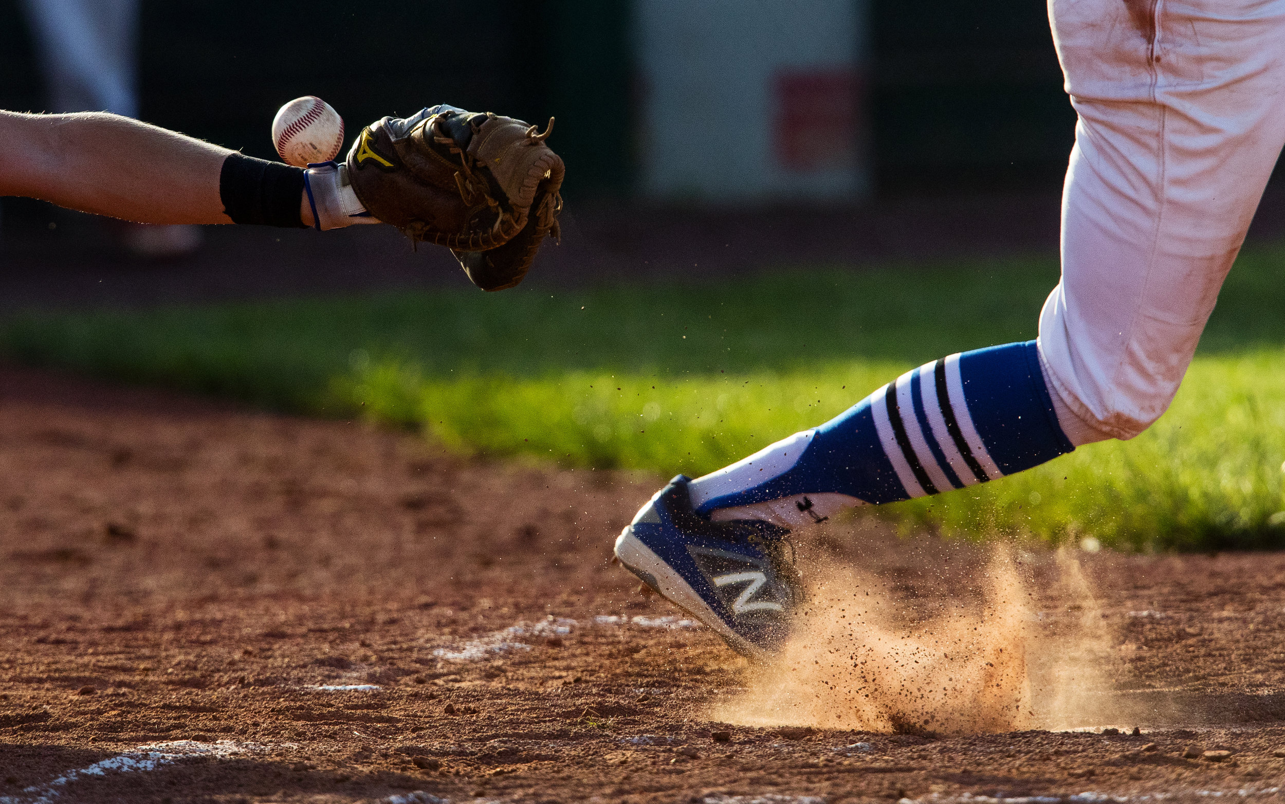 A low pitch hits the dirt and bounces over the catcher's mitt during the Baseball Classic at Claude Kracik Field at Lincoln Land Community College Tuesday, June 12, 2018. [Ted Schurter/The State Journal-Register]