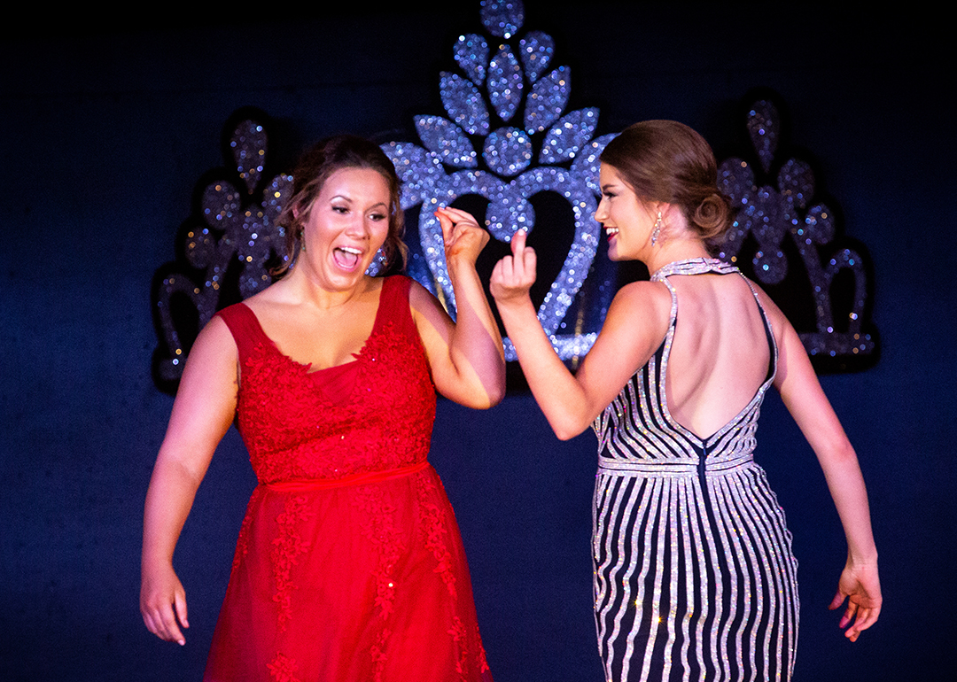 Claire Moore, left, and Sara Rotherham pass each other on the runway with a finger snap during the Sangamon County Fair Queen pageant Tuesday, June 12, 2018 at the Sangamon County Fairgrounds in New Berlin, Ill. [Rich Saal/The State Journal-Register]
