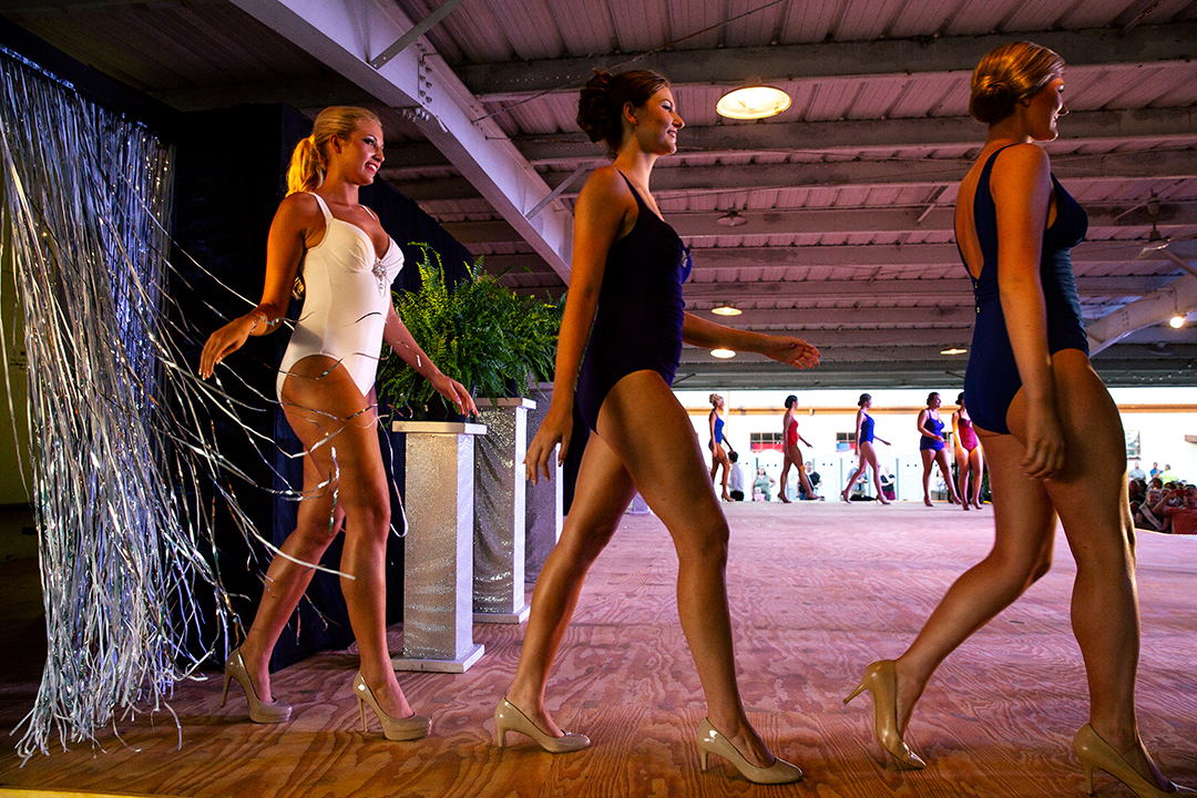 Contestants in the Sangamon County Fair Queen pageant swimsuit portion enter the stage Tuesday, June 12, 2018 at the Sangamon County Fairgrounds in New Berlin, Ill. [Rich Saal/The State Journal-Register]