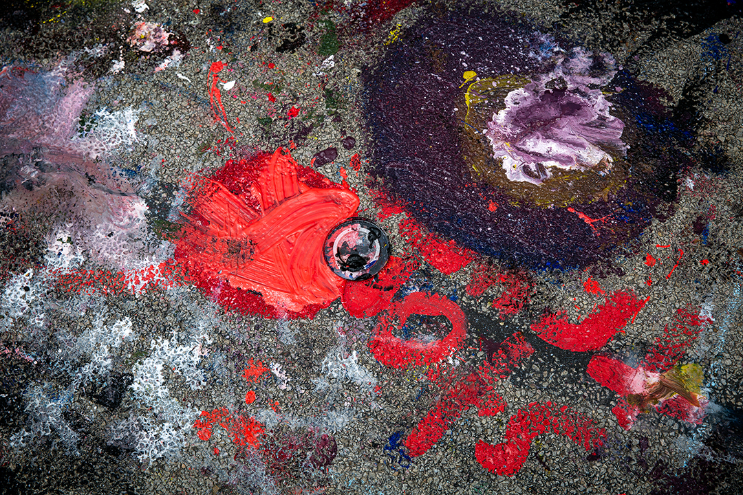 Spilled paint creates its own abstract artwork during the 2018 Paint the Street festival hosted by the Springfield Art Association Saturday, June 23, 2018 on Washington Street in Springfield, Ill. [Rich Saal/The State Journal-Register]