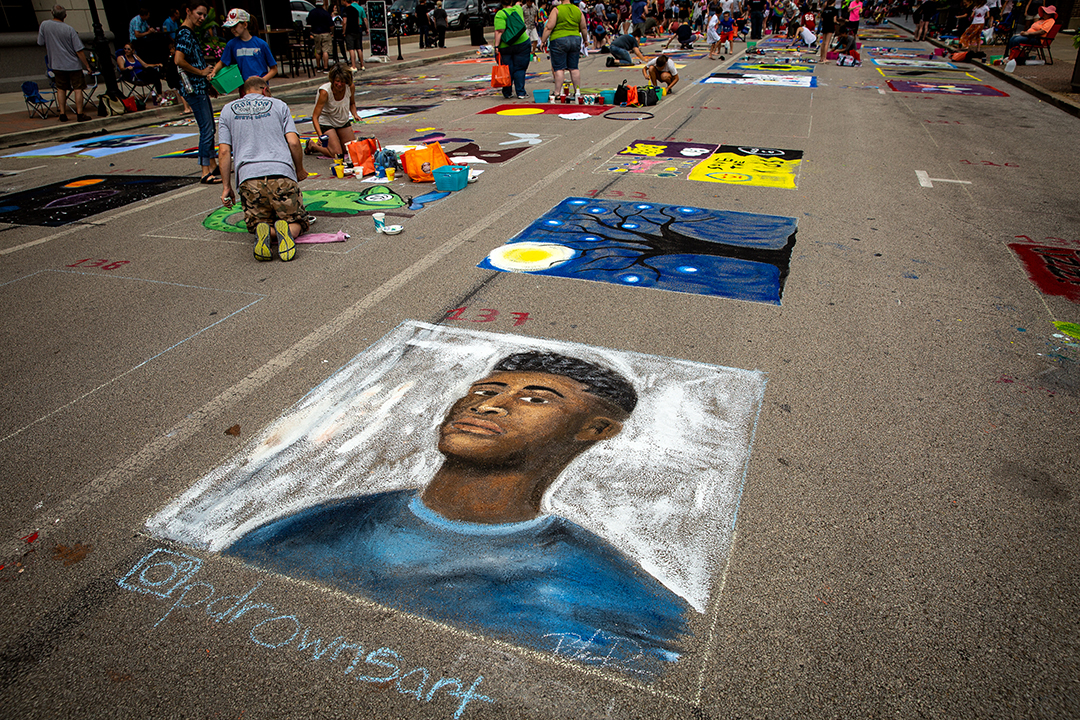 Parker Drowns' portrait at the 2018 Paint the Street festival hosted by the Springfield Art Association Monday, June 18, 2018 on Washington Street in Springfield, Ill. [Rich Saal/The State Journal-Register]