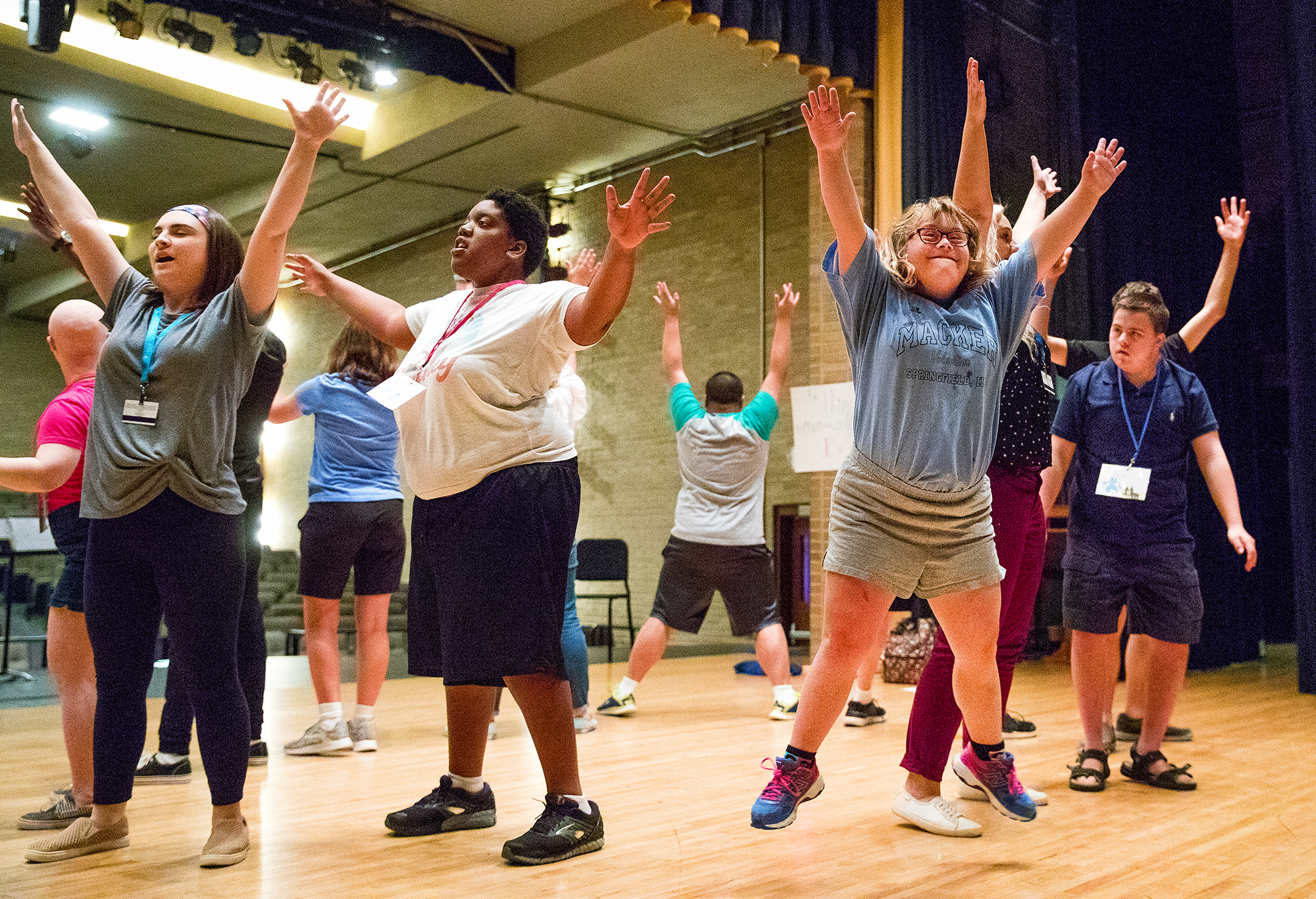 "Shelbie leaps into the air as she rehearses the song ""We've Got Magic to Do,"" during the inaugural Hope Theater Inclusion Camp at the Sacred Heart-Griffin auditorium Monday, June 18, 2018. Campers are learning about prop making, set painting, costumes and more in addition to learning the songs and dances for their showcase presentation of ""The YOUnique Circus"" Friday, June 29th at 3:15 p.m. in the SHG auditorium. The camp offers a second session beginning July 9, 2018. [Ted Schurter/The State Journal-Register]"