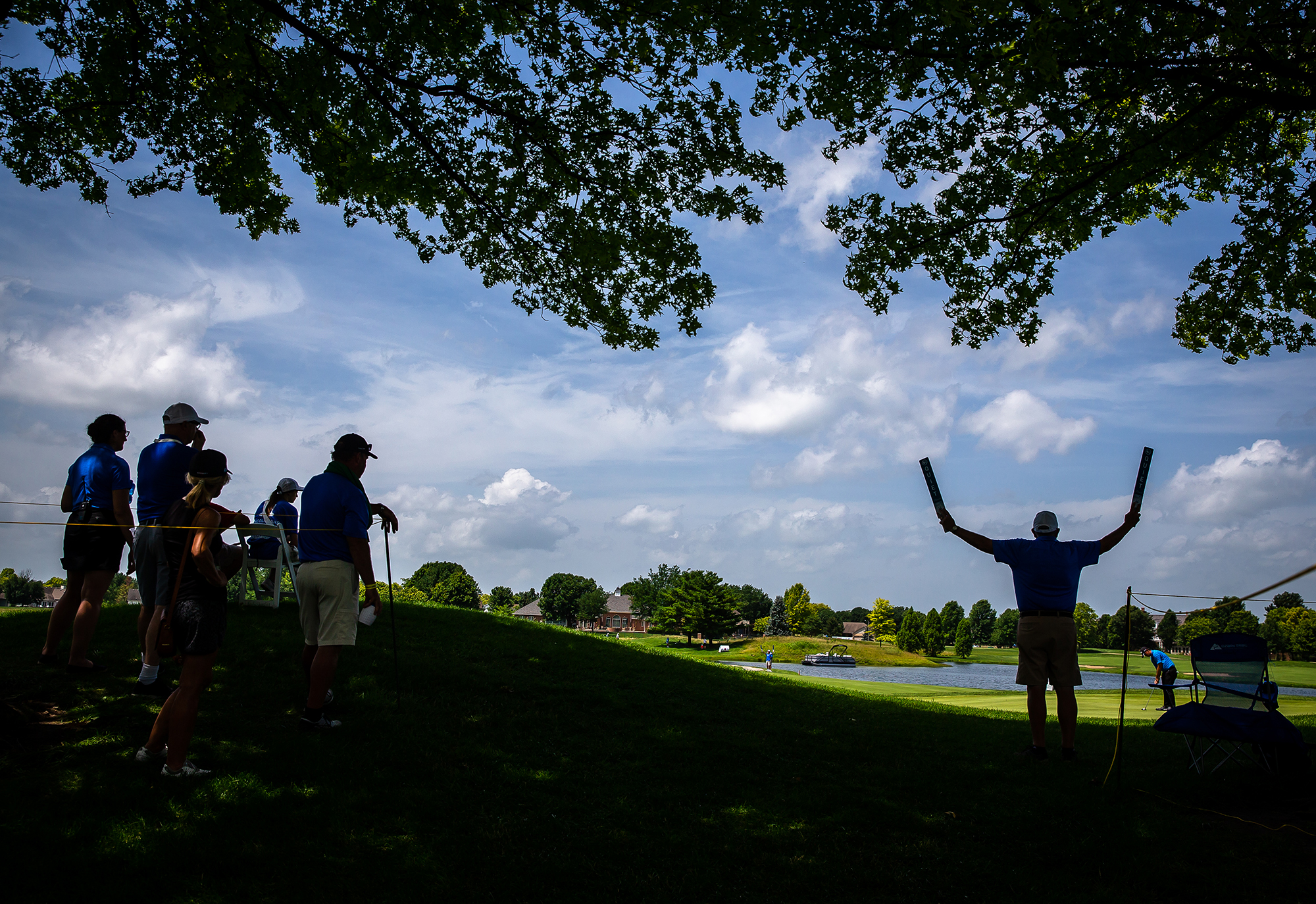 Volunteers signal the crowd to be quiet as golfers putt on the No. 9 hole during the Lincoln Land Championship presented by LRS at Panther Creek Country Club, Sunday, July 1, 2018, in Springfield, Ill. [Justin L. Fowler/The State Journal-Register]