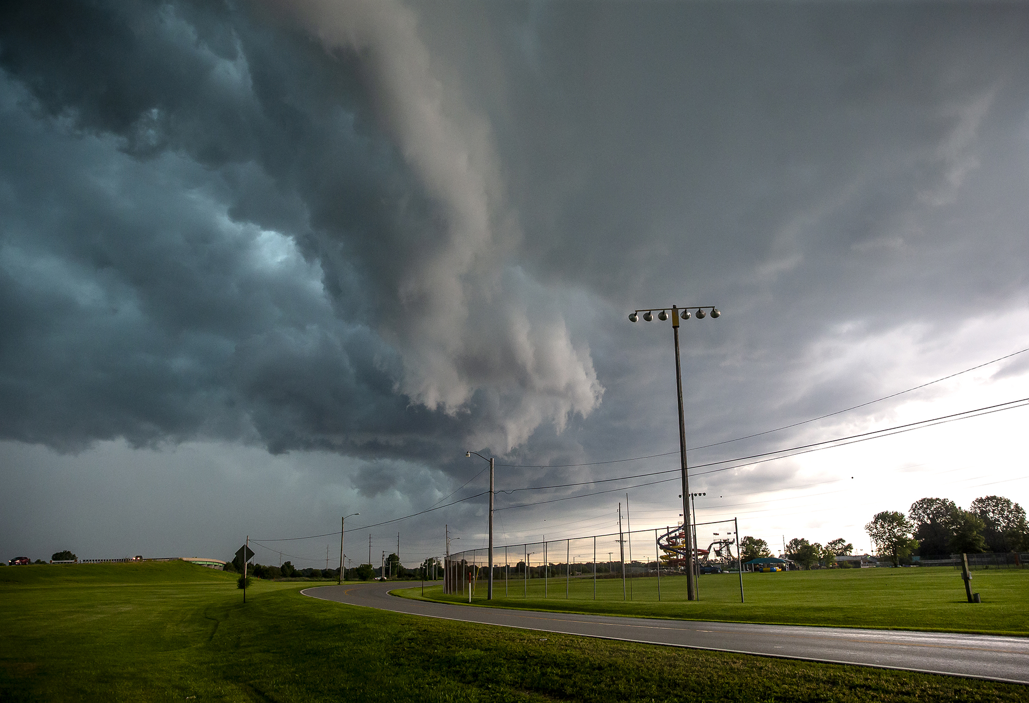 The leading edge of a severe thunderstorm billows over Knights Action Park triggers sever thunderstorm warnings throughout the Springfield area, Thursday, June 28, 2018, in Springfield, Ill. The storm knocked out power to over 600 CWLP customers in 19 outage areas. [Justin L. Fowler/The State Journal-Register]
