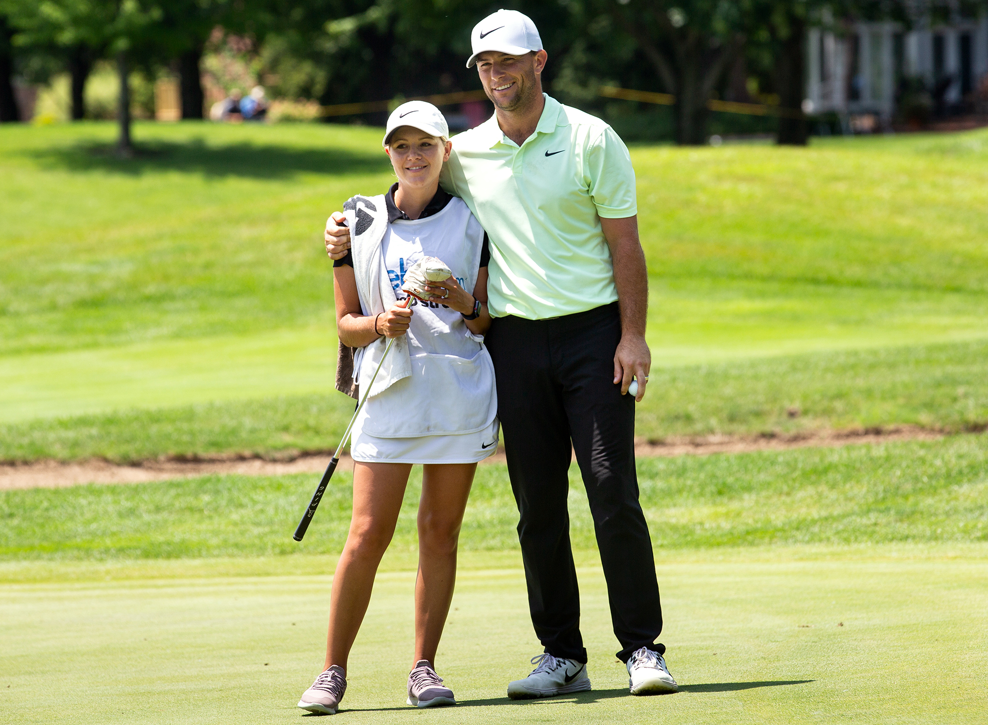 Luke Guthrie hugs his wife, Kaitlyn, who caddied for him, after he finished his second round play at 6 under par at the Lincoln Land Championship Friday, June 29, 2018 at Panther Creek Country Club in Springfield, Ill. [Rich Saal/The State Journal-Register]