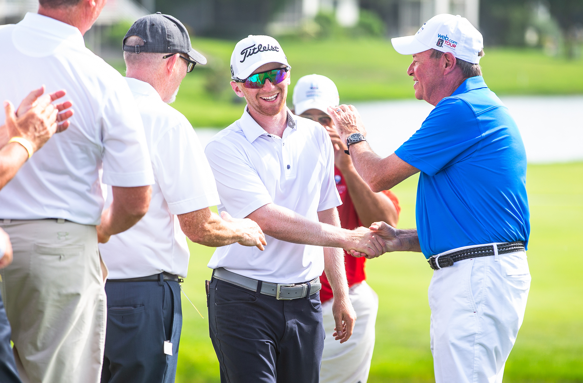 Anders Albertson is congratulated as he walks up to the 18th green to receive his trophy after winning the Lincoln Land Championship presented by LRS at Panther Creek Country Club, Sunday, July 1, 2018, in Springfield, Ill. [Justin L. Fowler/The State Journal-Register]