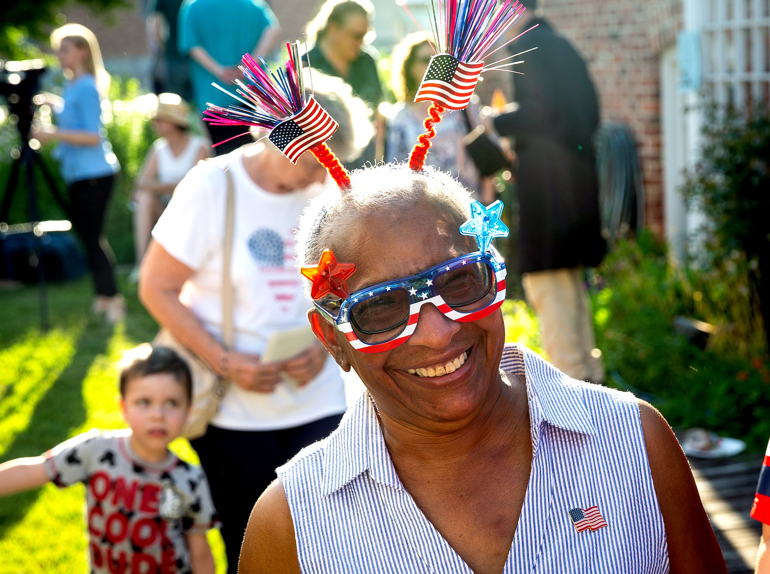 Kathryn Harris wore patriotic sunglasses and deely boppers to Clara Irwin's Annual Strawberry Party and Independence Day Celebration Wednesday, July 4, 2018 at the Iles House in Springfield, Ill. [Rich Saal/The State Journal-Register]