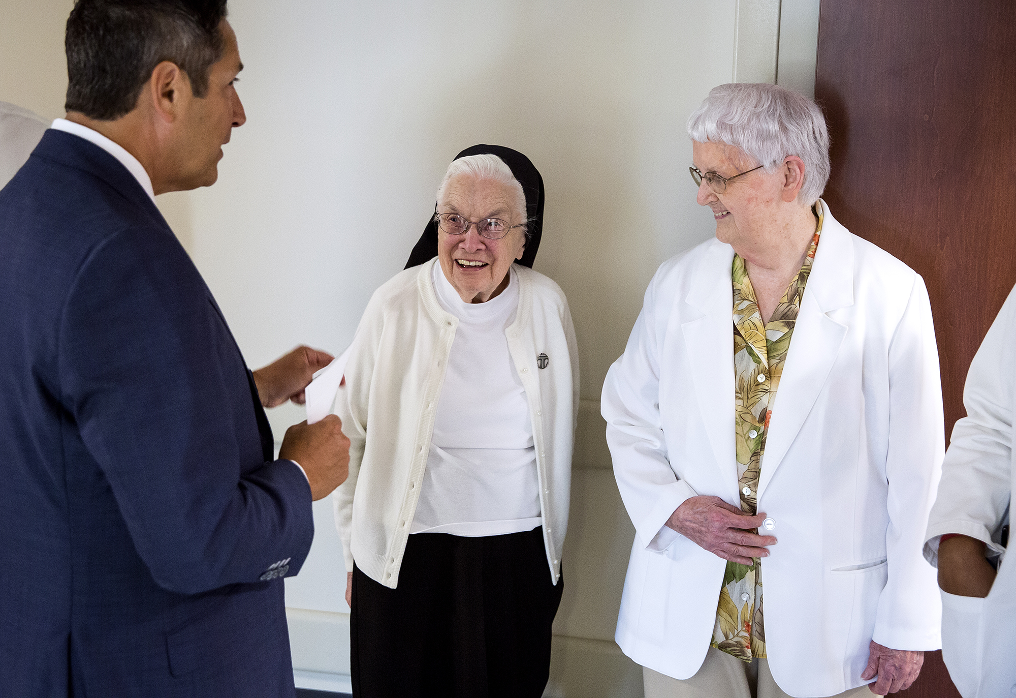 Dr. Gregory Mishkel, executive medical director of Prairie Heart Institute at HSHS St. JohnÕs Hospital, talks with Sr.Jonette Devlin, OSF, and Sr. Mary Creedon, OSF, both former ICU nurses, during a blessing for the institute's new cardiovascular intensive care unit  Monday, July 9, 2018 in Springfield, Ill. Sr. Devlin helped care for the hospital's first open heart surgery patient in 1965. [Rich Saal/The State Journal-Register]