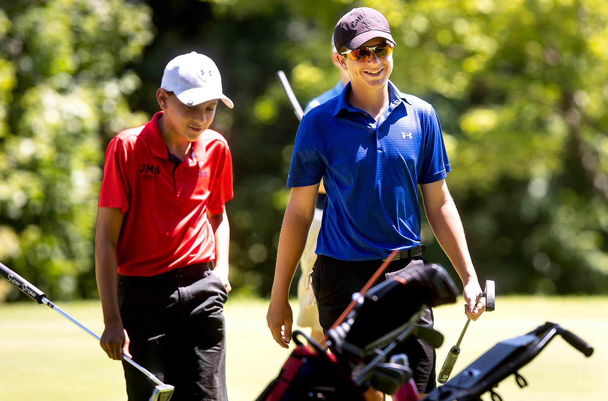 A usually friendly game between cousins, Tysyn Mast, left, and Aydin Folker, was competitive Wednesday, July 11, 2018 when the boys played each other for a berth in the championship flight title match of the Drysdale Junior Golf Tournament at Bunn Golf Course in Springfield, Ill. Folker's par on the 18th green gave up a 1-up semifinal decision over Mast. [Rich Saal/The State Journal-Register]