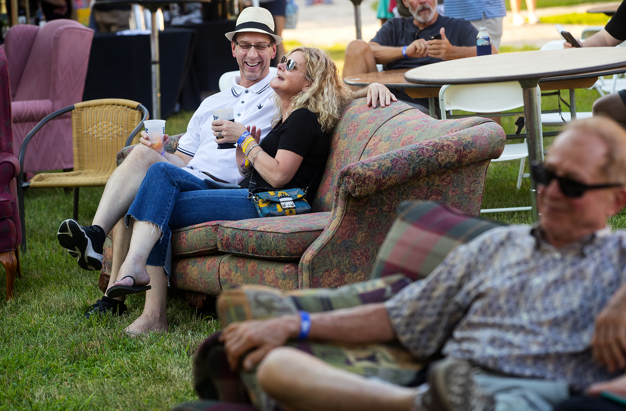 """Kurt Sames and Sue Ellen Busby laugh as they listen to music on the lawn of the Old State Capitol during the """"Amaranth Apple"""" Music & Food Fest Friday, July 13, 2018. The festival continues Saturday with free admission for guests under 12 years-old and $5 admission for everyone 13 years-old and up. [Ted Schurter/The State Journal-Register]"""