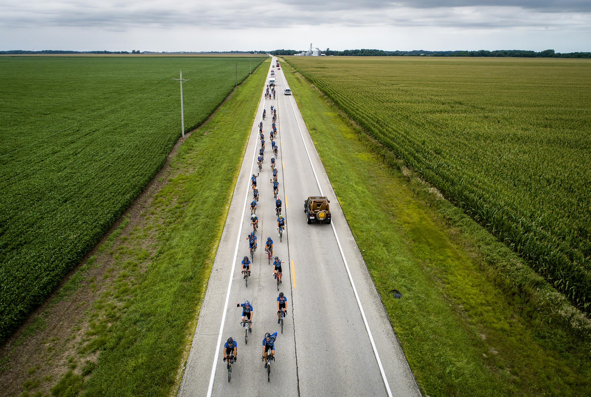 Cyclists with the Illinois Chapter of Concerns of Police Survivors (ÒC.O.P.SÓ) head east on Old Jacksonville Road during the 14th annual Cycle Across Illinois on their way to Springfield after beginning the day in Alton, Thursday, July 19, 2018, near New Berlin, Ill. Cycle Across Illinois is a charity bicycle ride to support the Illinois families of law enforcement officers who have died in the line of duty. The ride is over 300 miles and began at the Mississippi River in Alton, Ill., and will end at the Gold Star Families Memorial and Park in Chicago, Ill. [Justin L. Fowler/The State Journal-Register]