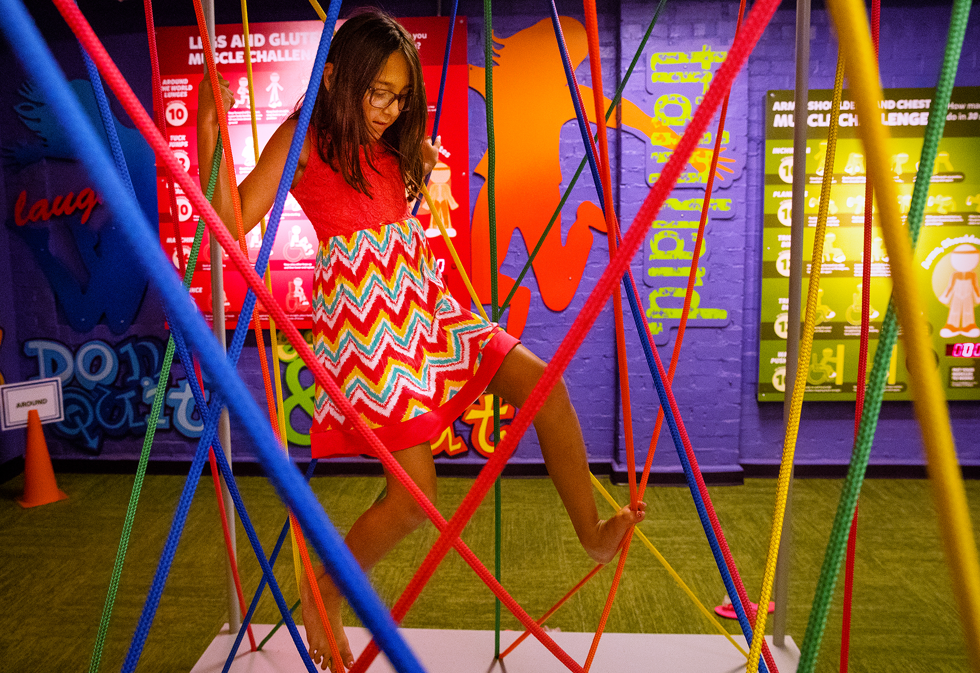 Arianna Johnston navigates the interactive rope exhibit during the Kidzeum of Health and Science grand opening Saturday, July 21, 2018. [Ted Schurter/The State Journal-Register]