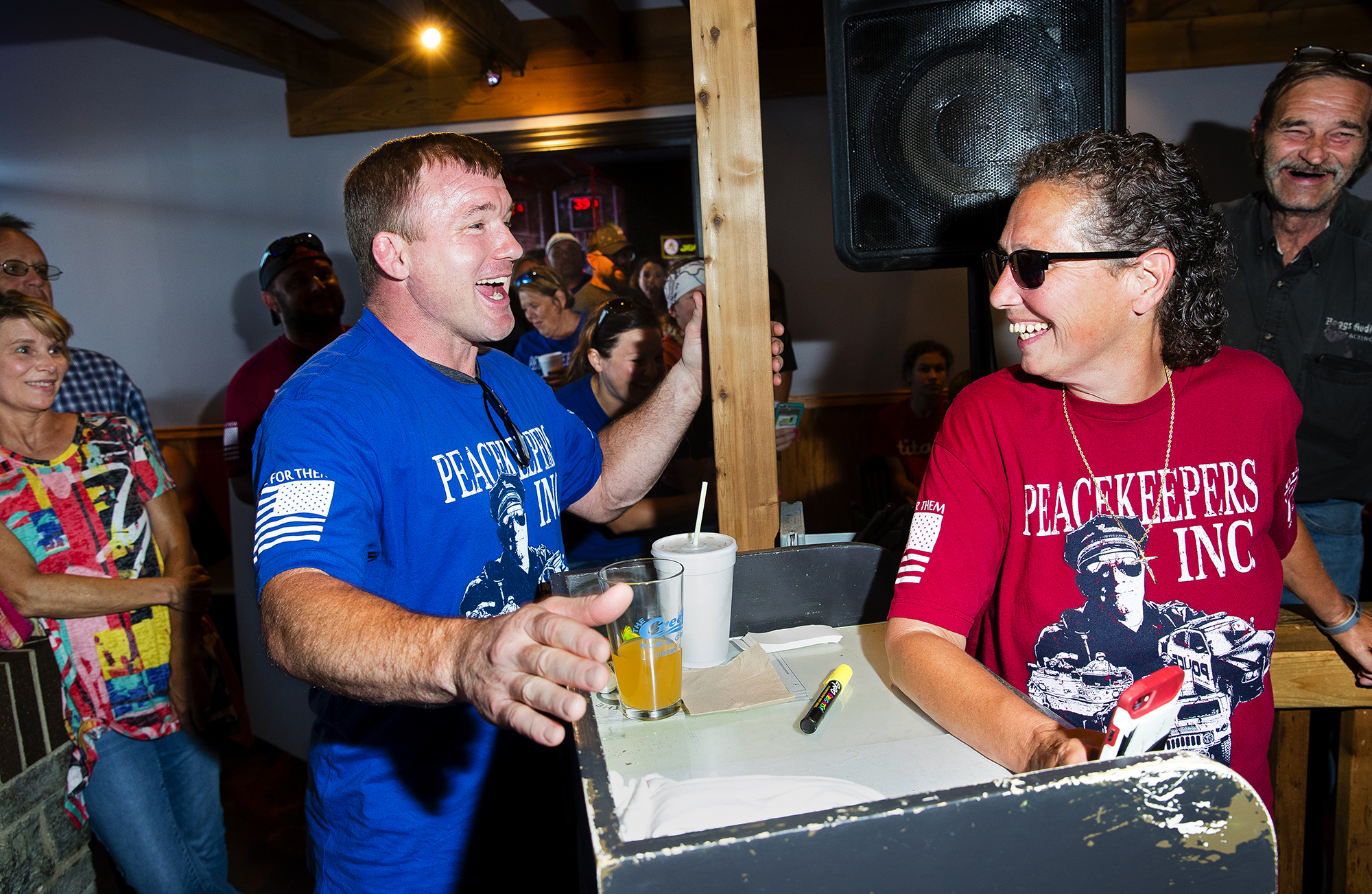 Former UFC welterweight champion and Hillsboro native Matt Hughes jokes with the crowd at The Creek Pub & Grill in Chatham during a stop on the 2018 Peacekeepers Ride Sunday, July 22, 2018. Hughes was the ride's honorary grand marshall. [Ted Schurter/The State Journal-Register]