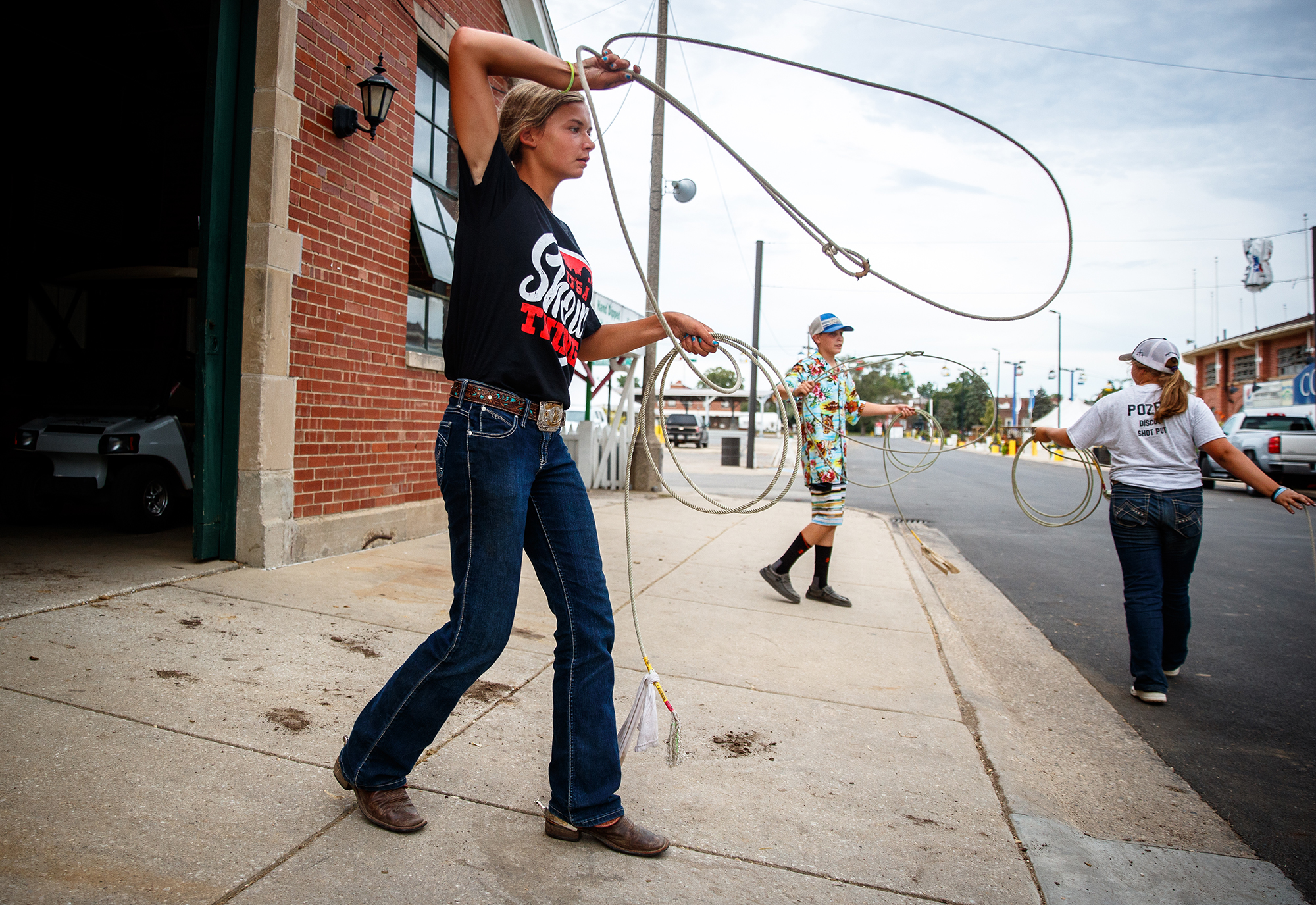 Audrey Breen, 12, of Newark, Ill., left, practices her roping skills along with Duncan Smith, 13, of Macomb, Ill., and Zoey Pozen, 13, of Elburn, Ill., right, as they wind down from of the daily activities outside the barns during the week of the Junior Horse and Pony Show on the Illinois State Fairgrounds, Wednesday, July 25, 2018, in Springfield, Ill. Breen and Duncan are competing in various horsemanship contests with other youth from across the state during the week long event which has daily events through Sunday. [Justin L. Fowler/The State Journal-Register]