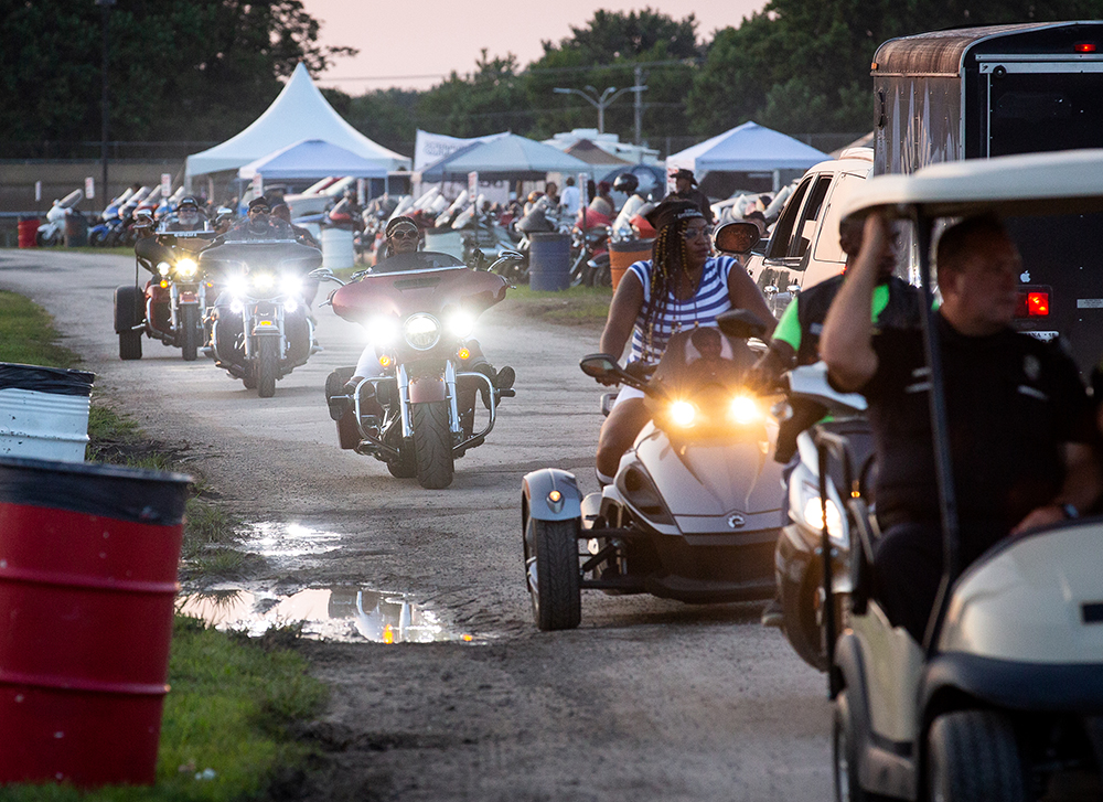 Motorcycles stream into the mile track infield on the opening night of the National Bikers Roundup Wednesday, Aug. 1, 2018 Illinois State Fairgrounds in Springfield, Ill. [Rich Saal/The State Journal-Register]