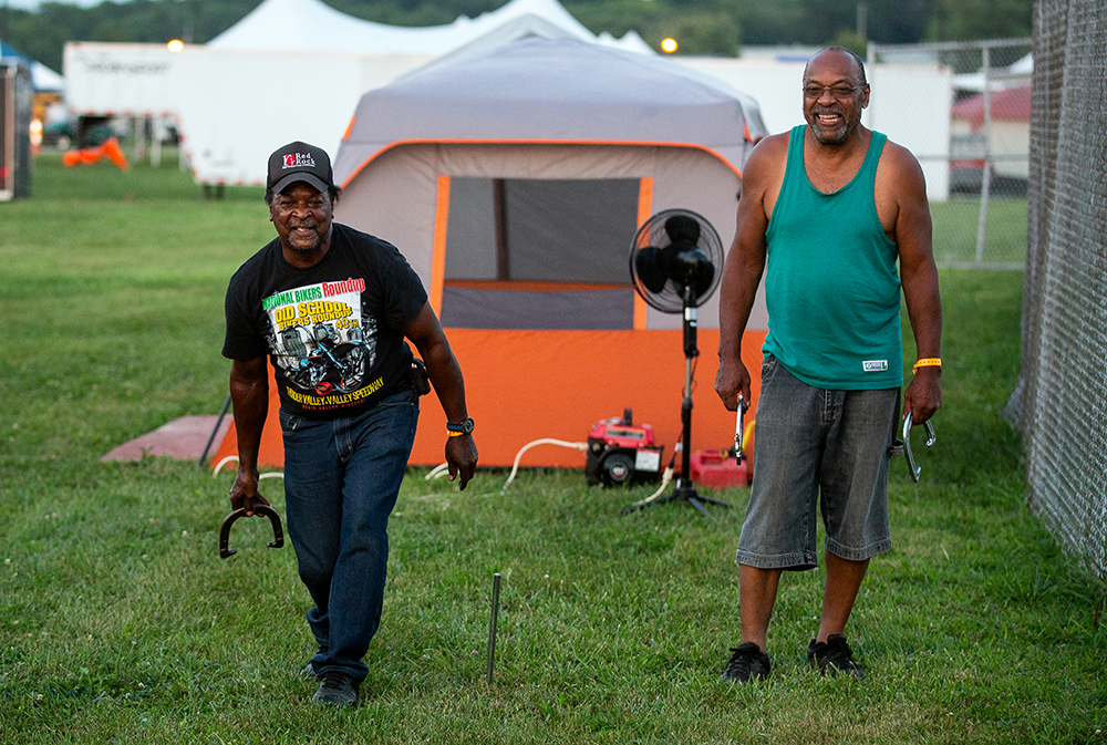 Roy Sneed, left, and Wayne Parker pitch horse shoes near their tent in the mile track infield at the National Bikers Roundup Wednesday, Aug. 1, 2018 Illinois State Fairgrounds in Springfield, Ill. The men are members of the Nasty Boys Motorcycle Club in Oklahoma. [Rich Saal/The State Journal-Register]