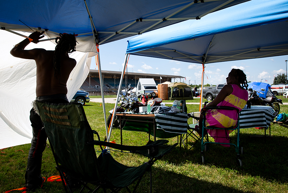 Terry Troupe and his wife, Ann Brewer set up their tent on the mile track infield at the National Bikers Roundup Wednesday, Aug. 1, 2018 Illinois State Fairgrounds in Springfield, Ill. The Troupes are from Grand Rapids, Mich.[Rich Saal/The State Journal-Register]