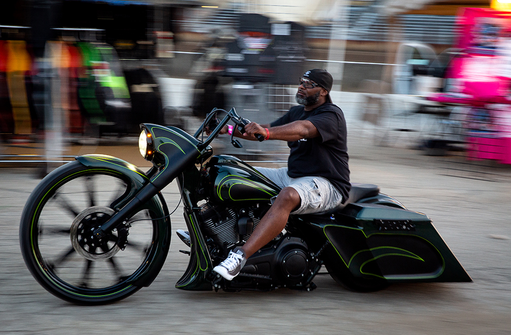 A custom motorcycle slides through the vendor area at the National Bikers Roundup Wednesday, Aug. 1, 2018 Illinois State Fairgrounds in Springfield, Ill. [Rich Saal/The State Journal-Register]