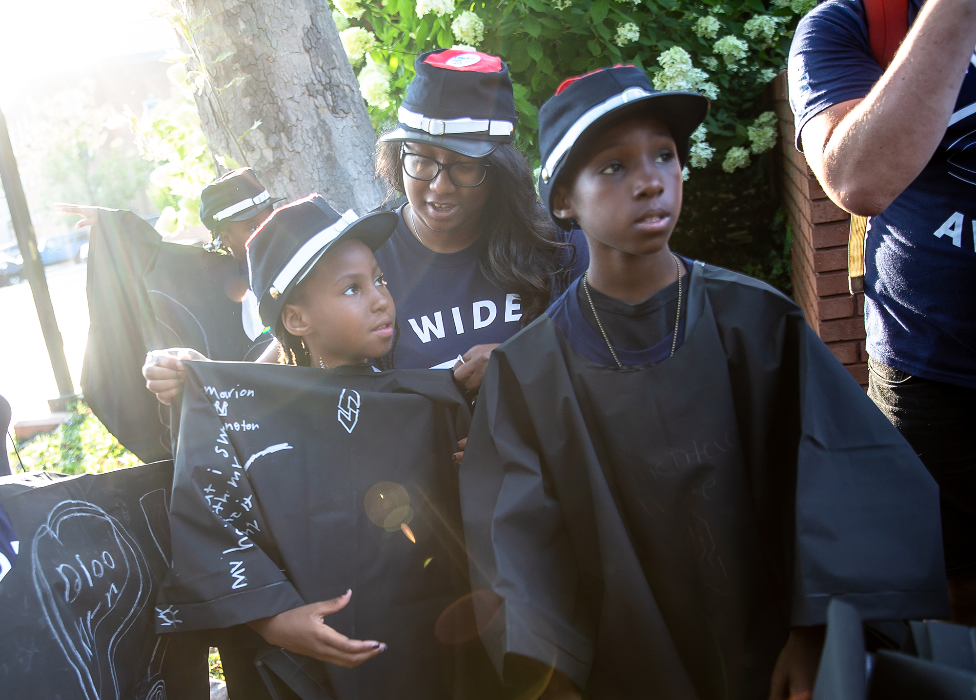 Jameia Ware, 8, center, dawns the black cap and hat for the uniforms of the Wide Awakes that she and her fellow youth from the Springfield Urban League made to use during the Lincoln Wide Awake Parade, a re-enactment of an 1860 parade to support Abraham LincolnÕs presidential candidacy, to the Old State Capitol from the Lincoln Home, Saturday, Aug. 4, 2018, in Springfield, Ill. The Wide Awakes, who wore black caps and black hats when they marched, got their name from a small group of young self-named supporters who impressed Lincoln at a political rally, according to the Journal of American History. [Justin L. Fowler/The State Journal-Register]
