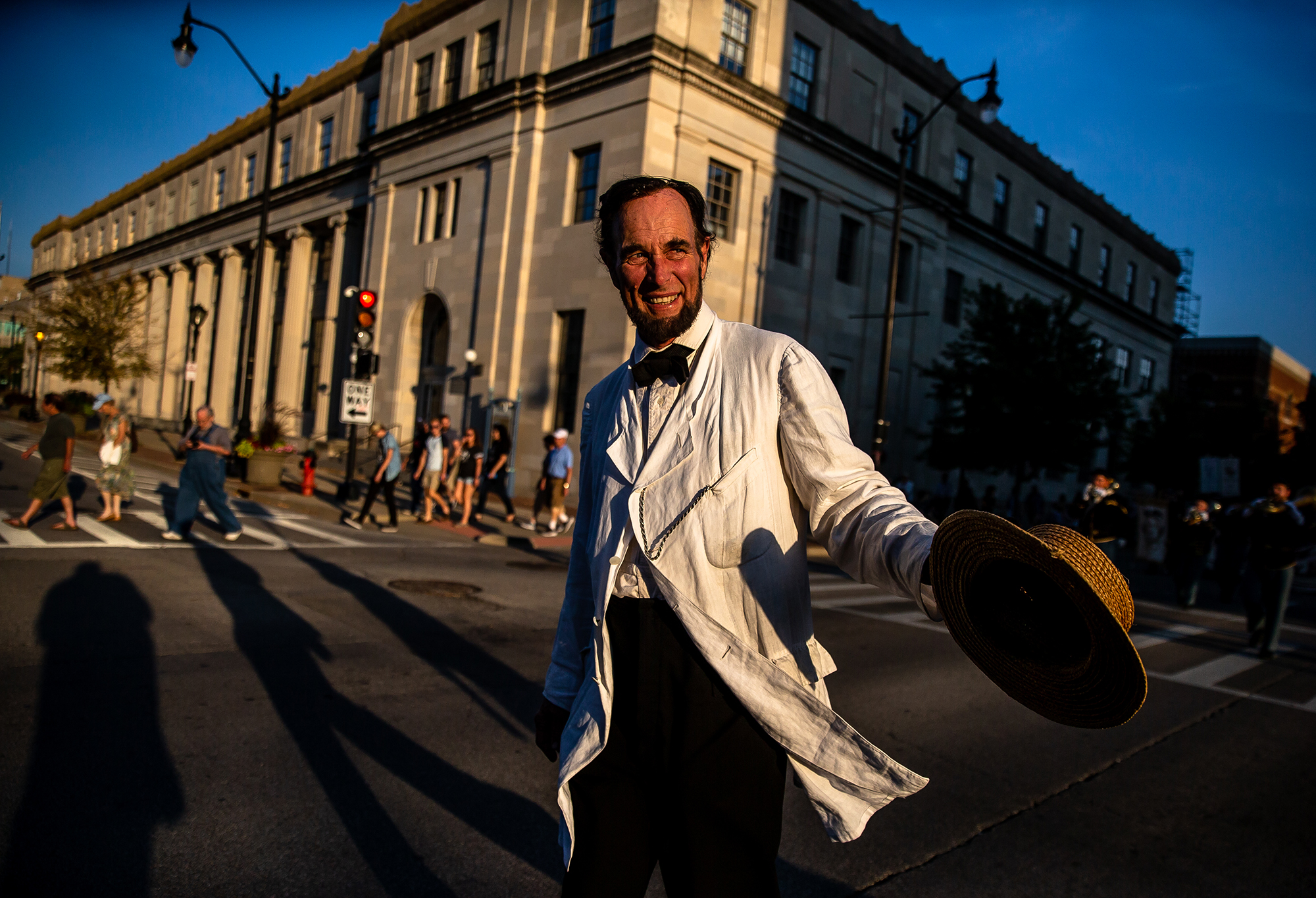 Fritz Klein portraying Abraham Lincoln heads up South Sixth Street being led by a  massive replica of a campaign ball during the Lincoln Wide Awake Parade, a re-enactment of an 1860 parade to support Abraham LincolnÕs presidential candidacy, as they march with the Wide Awakes to the Old State Capitol from the Lincoln Home, Saturday, Aug. 4, 2018, in Springfield, Ill. The Wide Awakes, who wore black caps and black hats when they marched, got their name from a small group of young self-named supporters who impressed Lincoln at a political rally, according to the Journal of American History. [Justin L. Fowler/The State Journal-Register]
