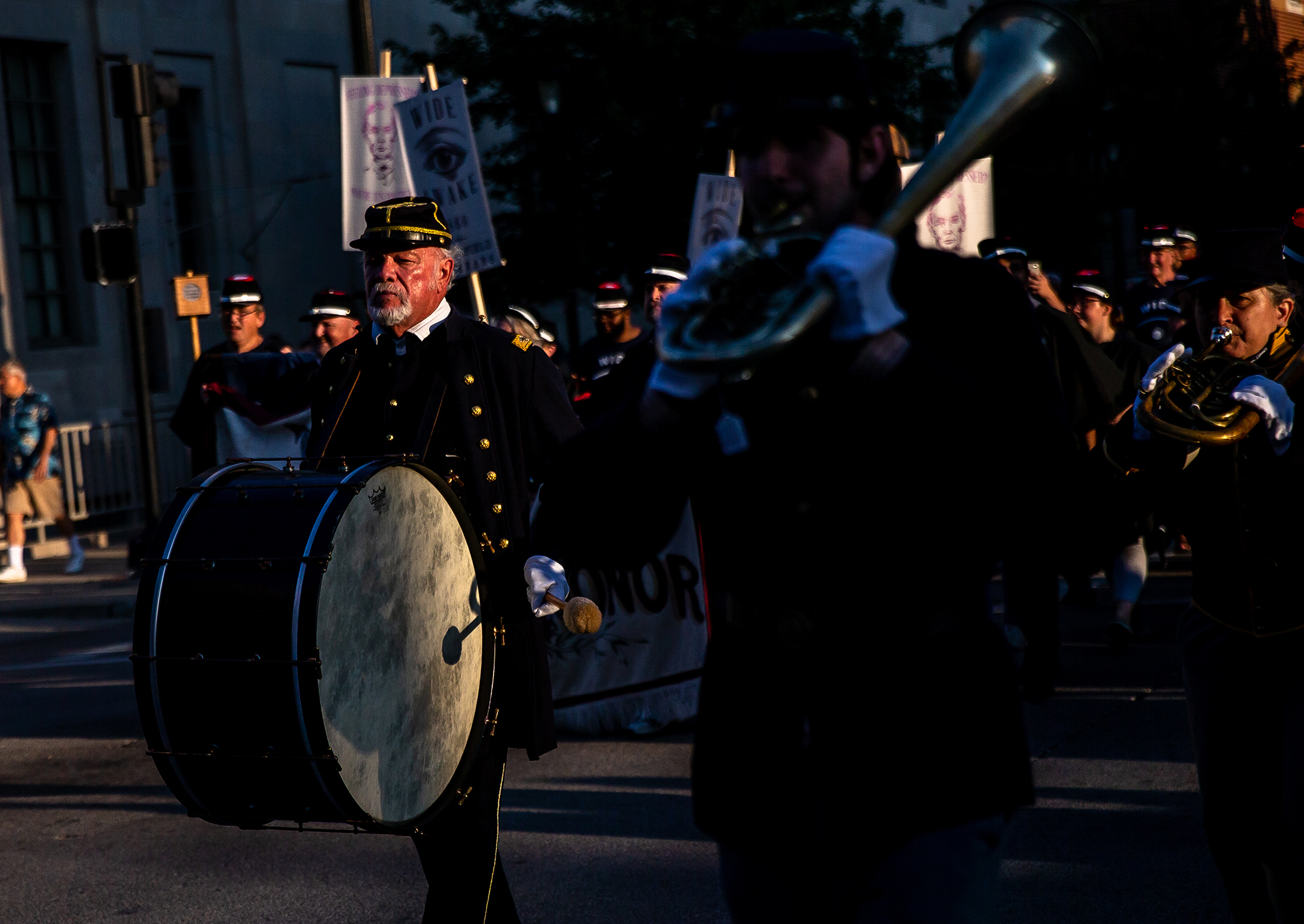 Members of the 10th Illinois Volunteer Cavalry RegimentBand march up South Sixth Street during the Lincoln Wide Awake Parade, a re-enactment of an 1860 parade to support Abraham LincolnÕs presidential candidacy, as they march with the Wide Awakes to the Old State Capitol from the Lincoln Home, Saturday, Aug. 4, 2018, in Springfield, Ill. The Wide Awakes, who wore black caps and black hats when they marched, got their name from a small group of young self-named supporters who impressed Lincoln at a political rally, according to the Journal of American History. [Justin L. Fowler/The State Journal-Register]