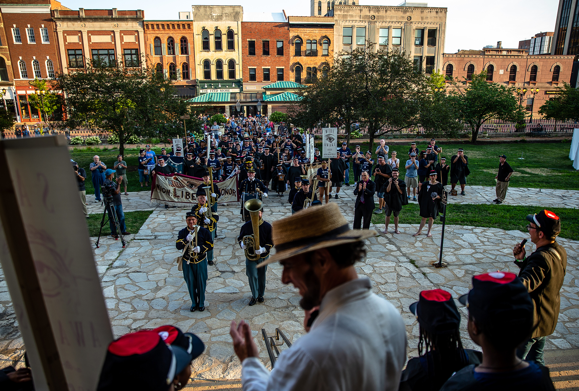 Members of the 10th Illinois Volunteer Cavalry RegimentBand are joined by the Wide Awakes after marching to the Old State Capitol from the Lincoln home during the Lincoln Wide Awake Parade, a re-enactment of an 1860 parade to support Abraham LincolnÕs presidential candidacy, Saturday, Aug. 4, 2018, in Springfield, Ill. The Wide Awakes, who wore black caps and black hats when they marched, got their name from a small group of young self-named supporters who impressed Lincoln at a political rally, according to the Journal of American History. [Justin L. Fowler/The State Journal-Register]