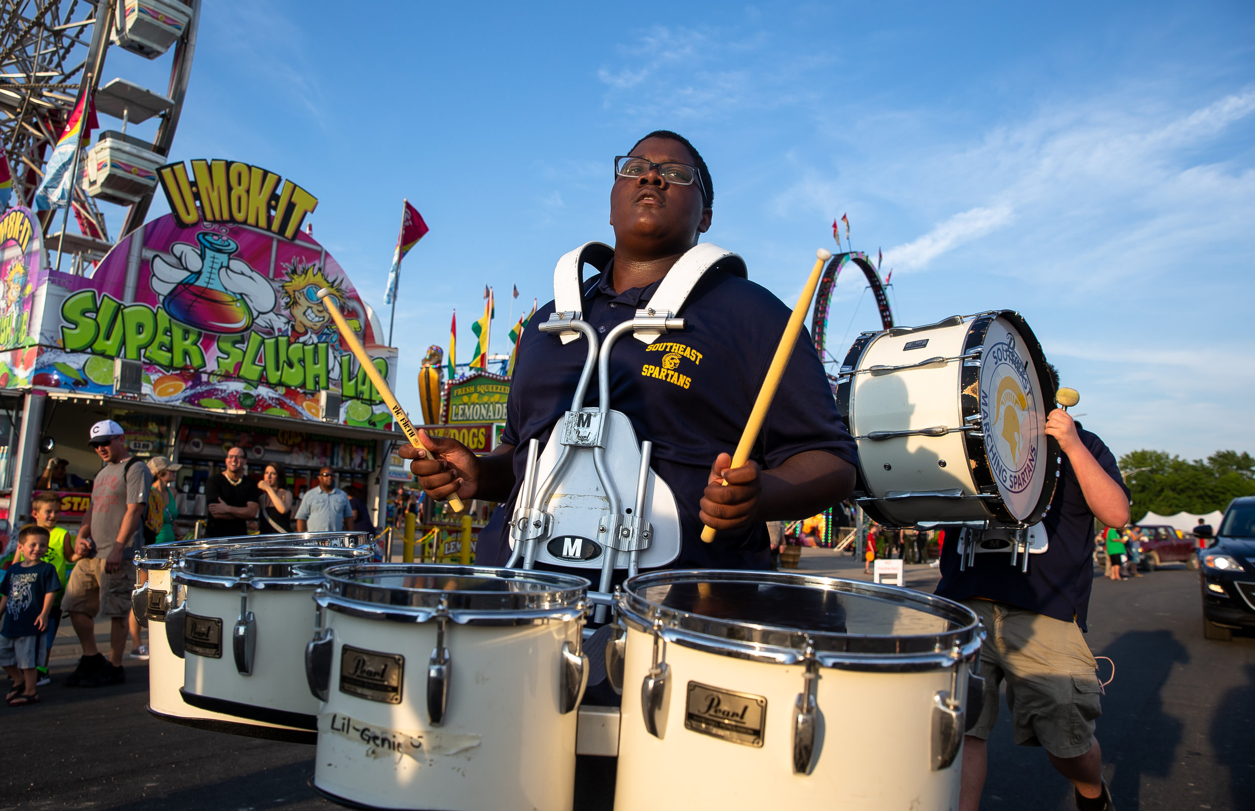 Members of the Southeast Marching Spartans perform as they march down Illinois Avenue during the Illinois State Fair Twilight Parade, Thursday, Aug. 9, 2018, in Springfield, Ill. [Justin L. Fowler/The State Journal-Register]