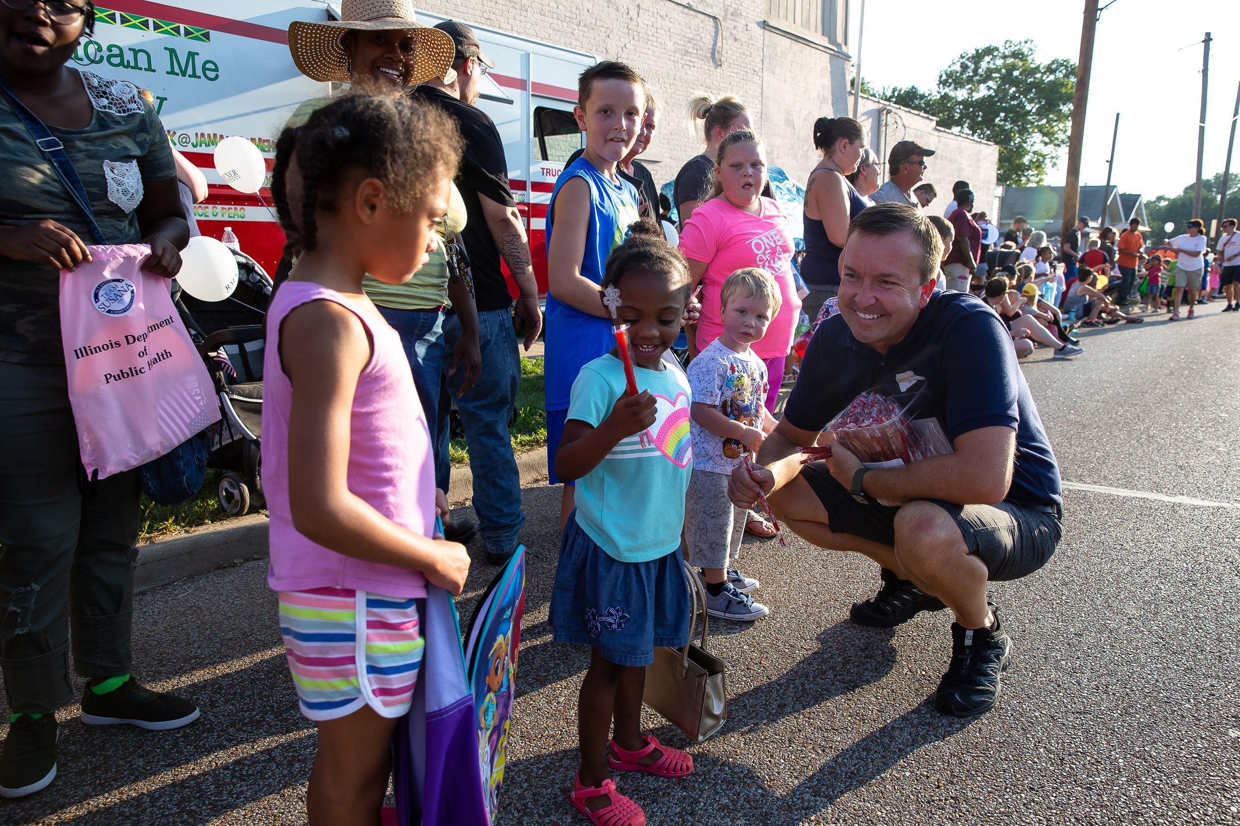 Illinois State Sen. Andy Manar, D-Bunker Hill, hands out Twizzlers to youth outside of the Main Gate during the Illinois State Fair Twilight Parade, Thursday, Aug. 9, 2018, in Springfield, Ill. [Justin L. Fowler/The State Journal-Register]