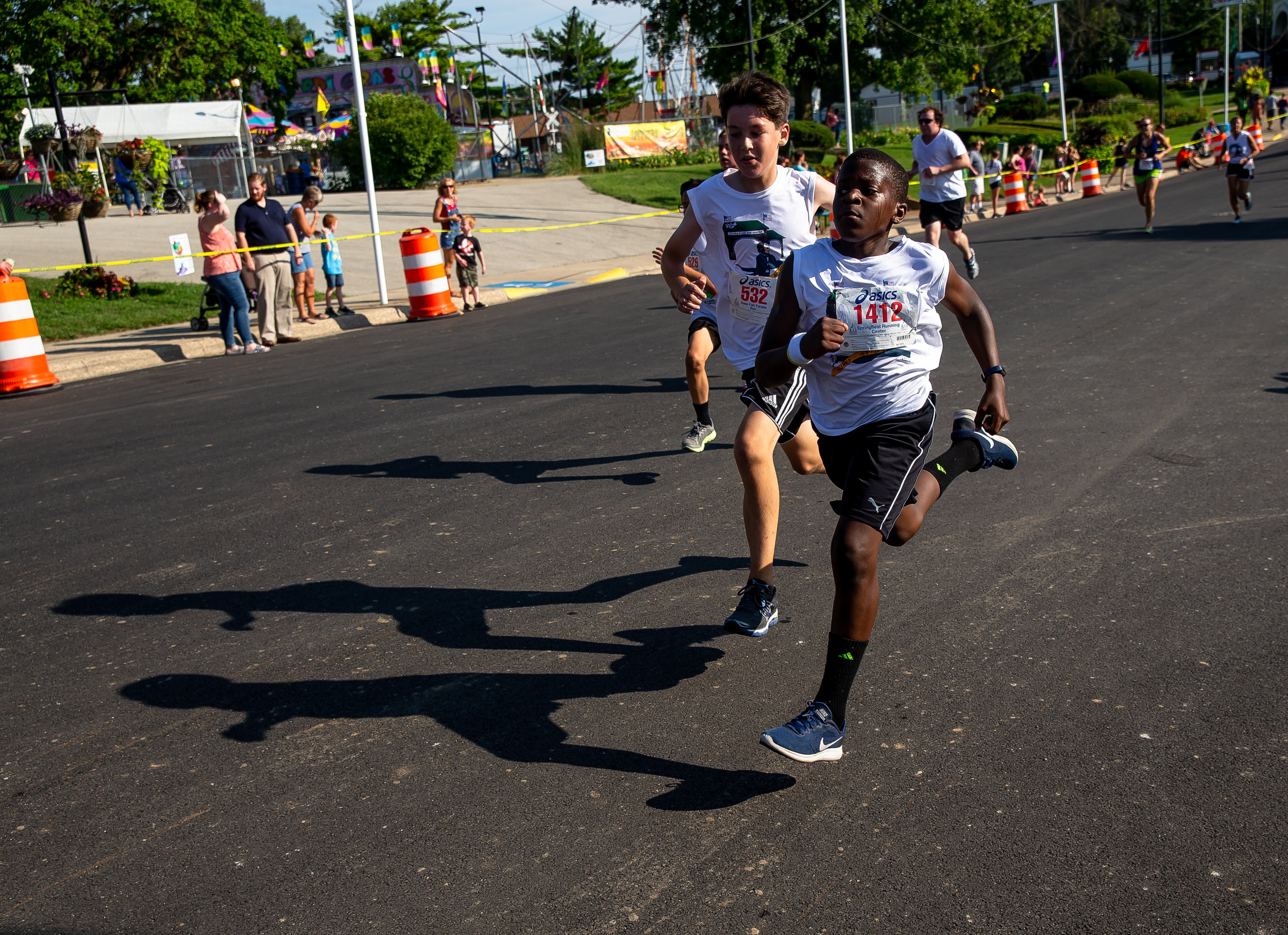 Luke Smith sprints out the final stretch of the Illinois State Fair Parade Run prior to the Illinois State Fair Twilight Parade, Thursday, Aug. 9, 2018, in Springfield, Ill. [Justin L. Fowler/The State Journal-Register]