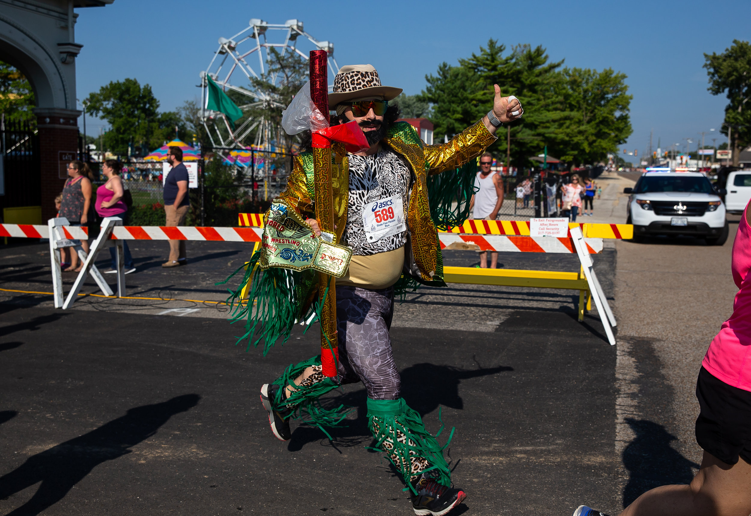 Jon Popovitch heads out the outbound leg of the Illinois State Fair Parade Run dressed as the Macho Man Randy Savage prior to the Illinois State Fair Twilight Parade, Thursday, Aug. 9, 2018, in Springfield, Ill. [Justin L. Fowler/The State Journal-Register]