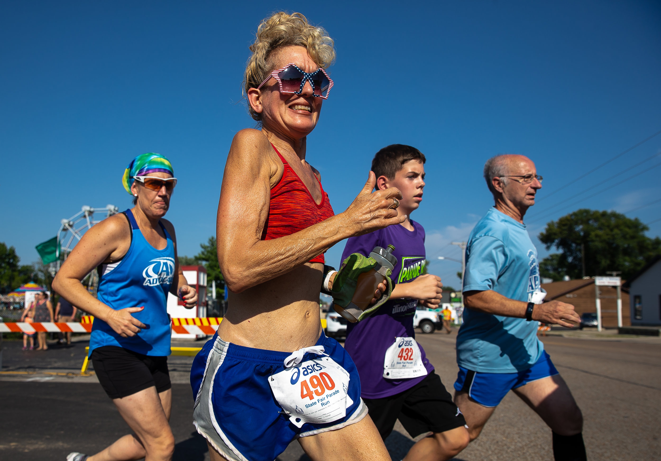 Kathleen Jensen heads out on Sangamon Avenue on the outbound leg of the Illinois State Fair Parade run prior to the Illinois State Fair Twilight Parade, Thursday, Aug. 9, 2018, in Springfield, Ill. [Justin L. Fowler/The State Journal-Register]